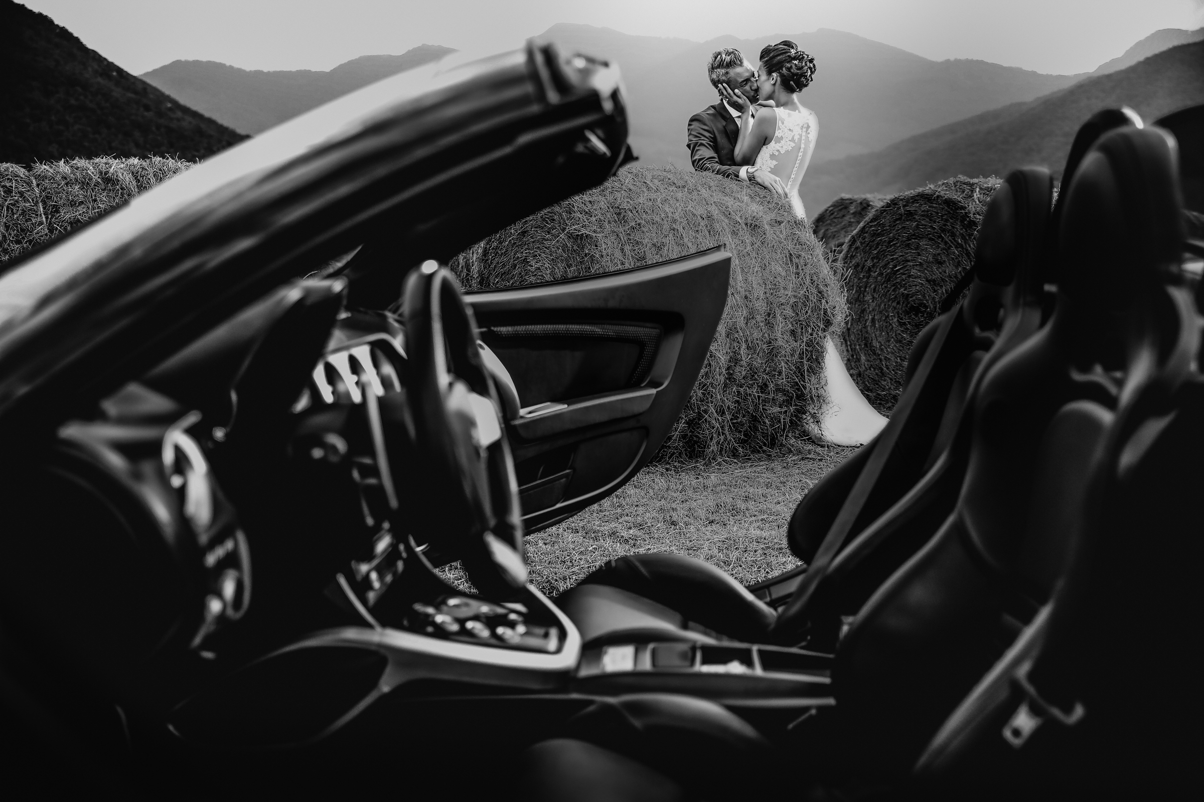 Couple against car and mountains - photo by Julien Laurent-Georges