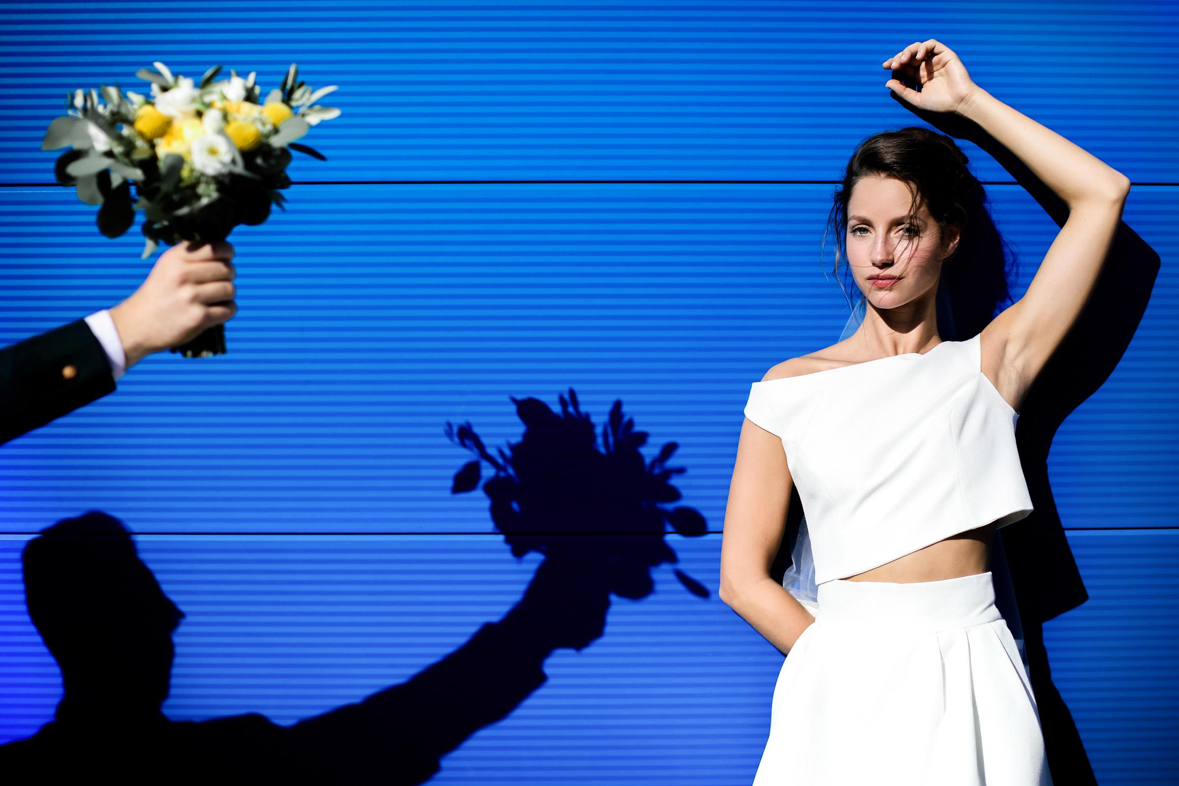 Geometric bride portrait with bouquet - photo by Julien Laurent-Georges