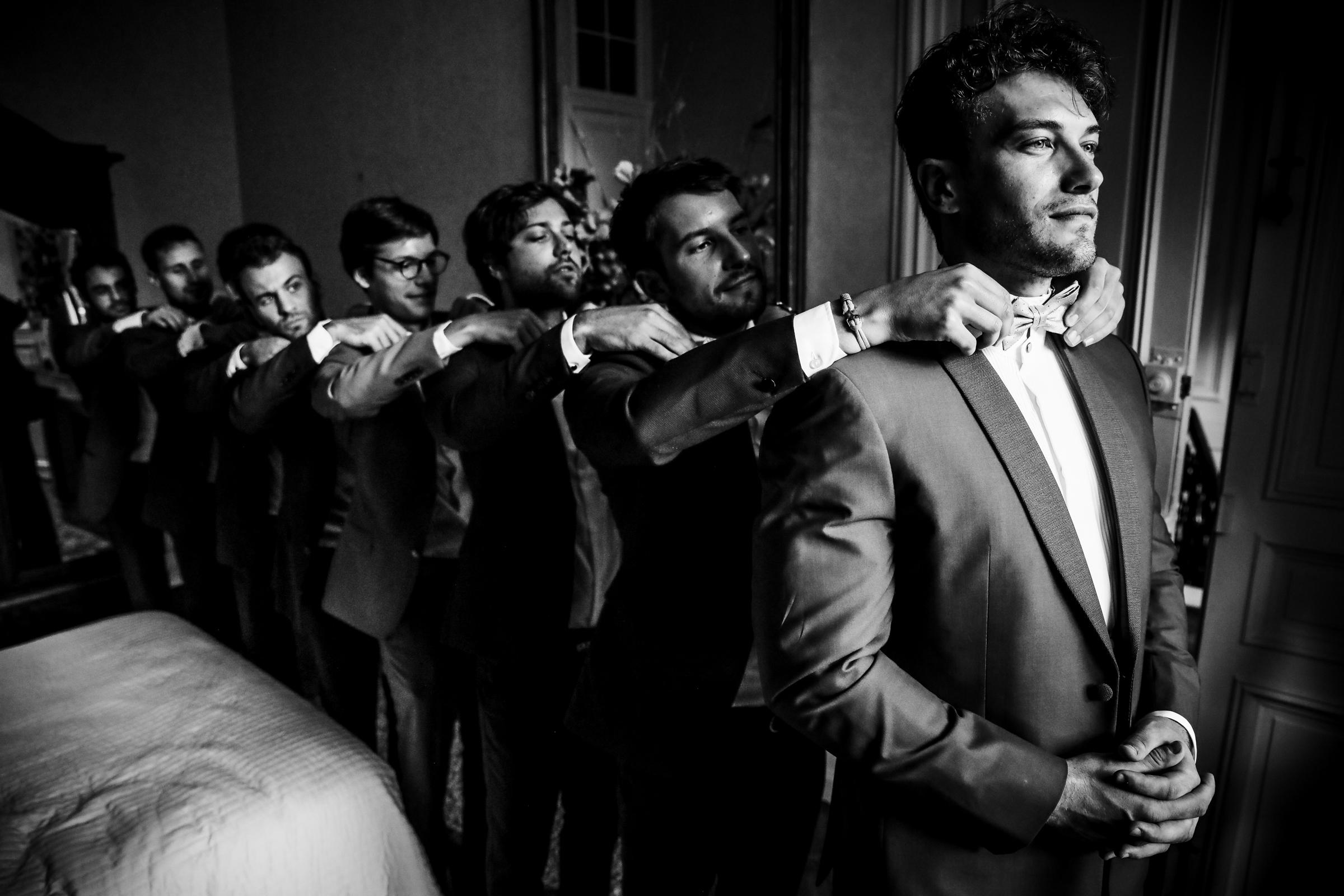 Groomsmen in a bowtie line - photo by Julien Laurent-Georges