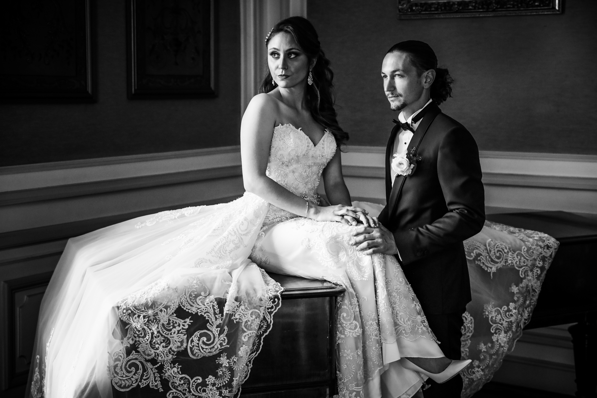Elegant portrait of groom in tux and bride in strapless dress - photo by Julien Laurent-Georges