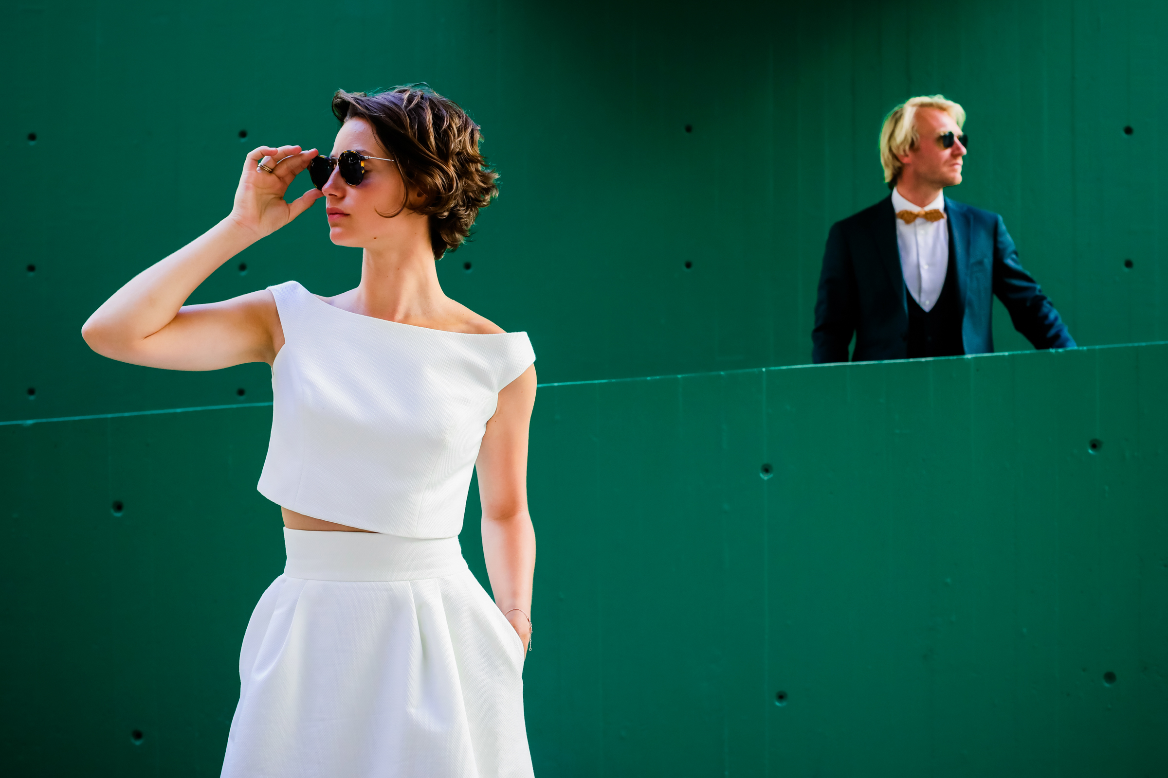 Stylish couple pose against green walls - photo by Julien Laurent-Georges