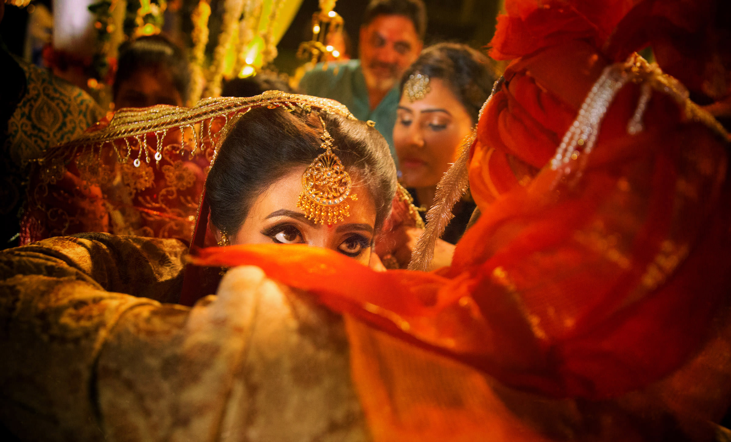 Bride's eyes looking up during Indian ceremony - photo by Shutterink Photography