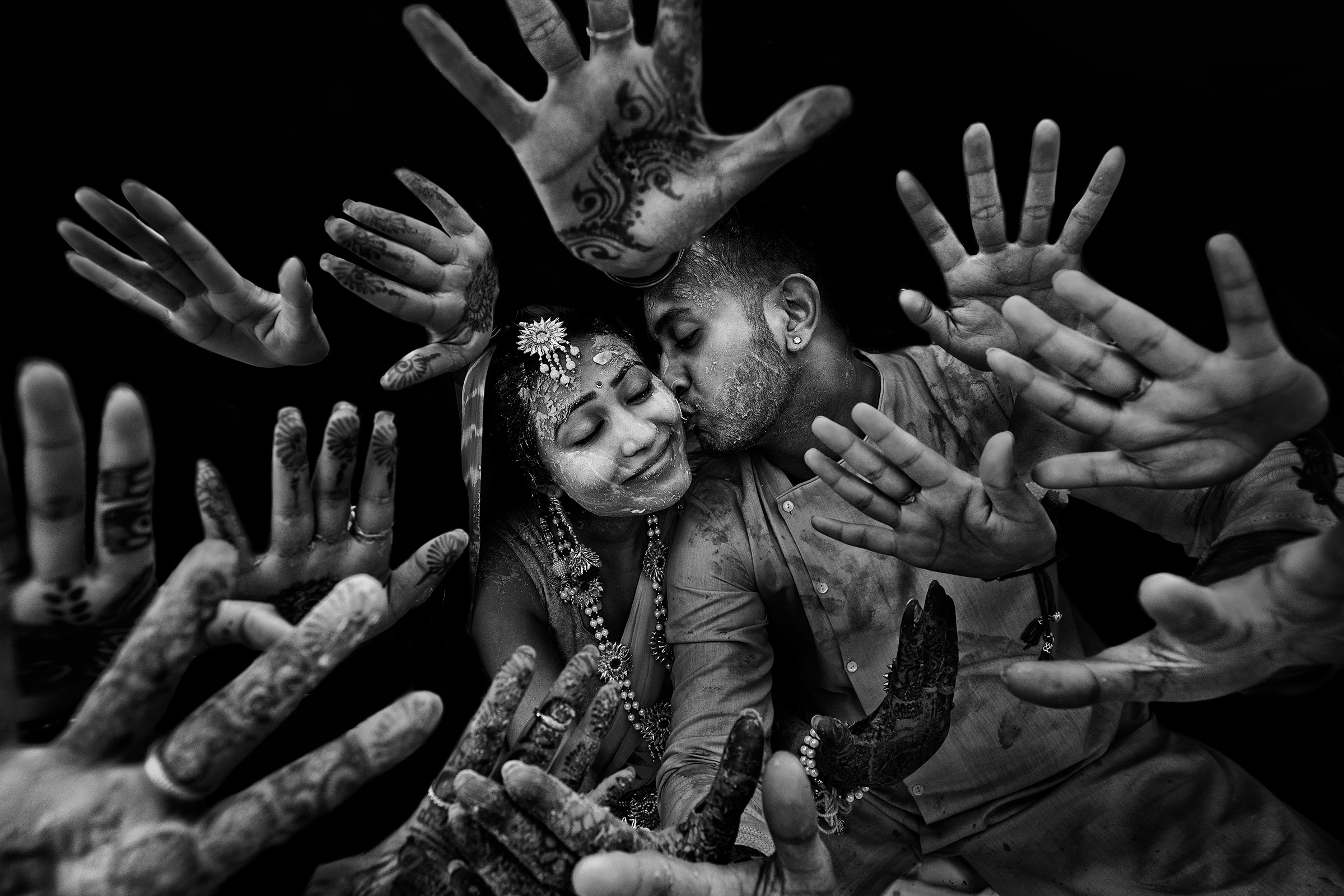 Bride and groom amidst hands - photo by Shutterink Photography
