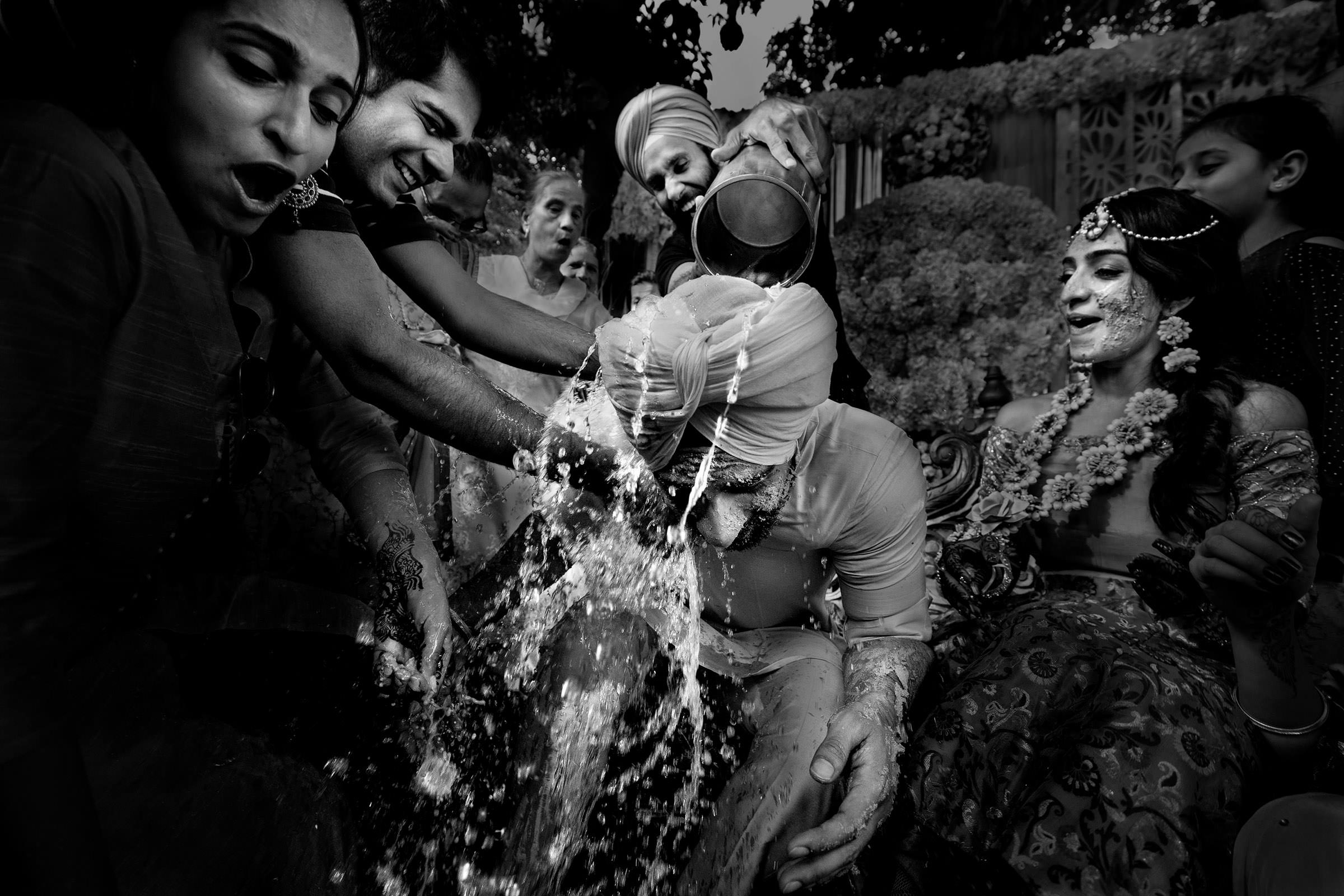 Indian groom blessed with water- photo by Shutterink Photography