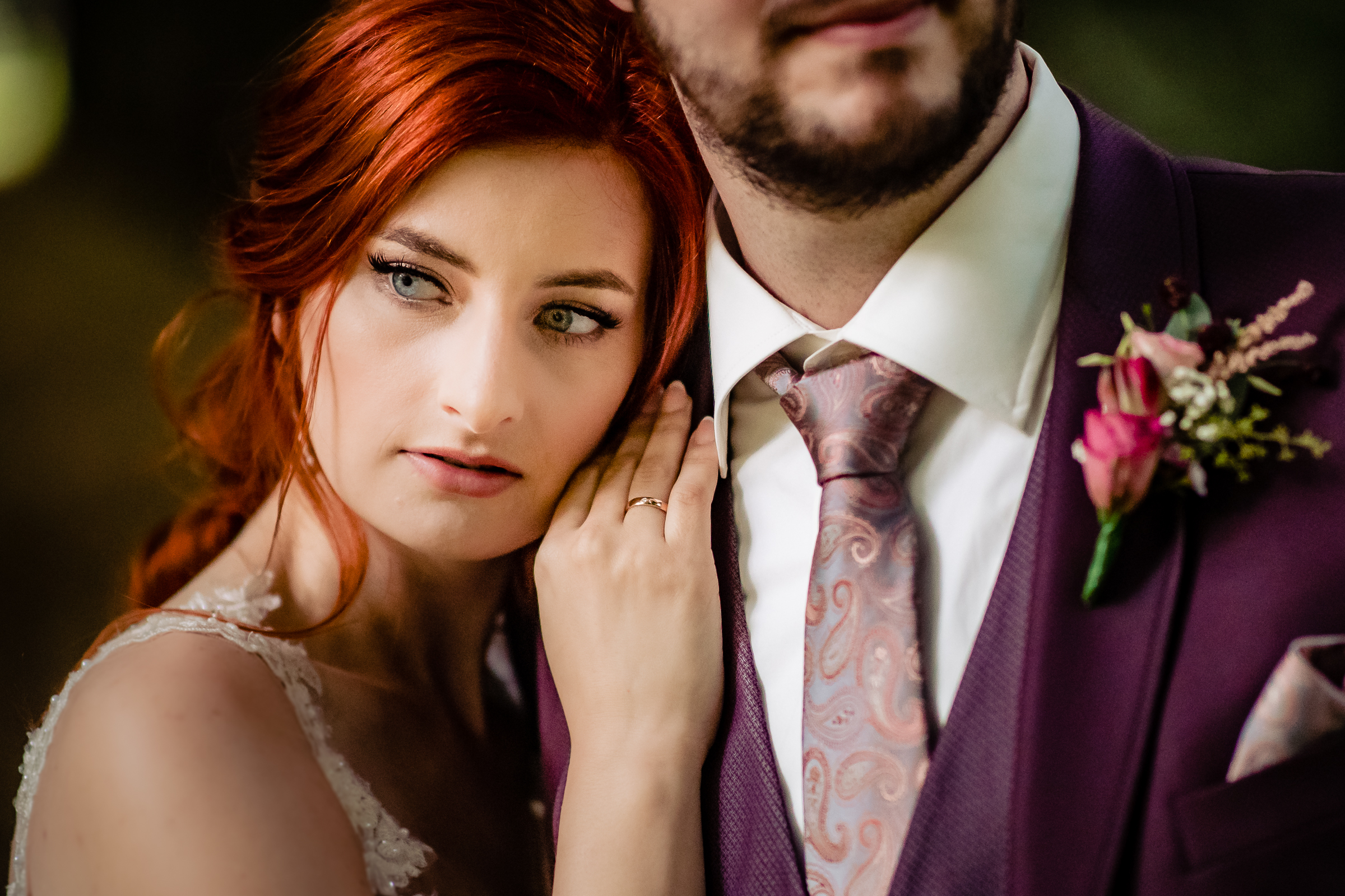 Bridal portrait on grooms shoulder -  photo by Eppel Photography