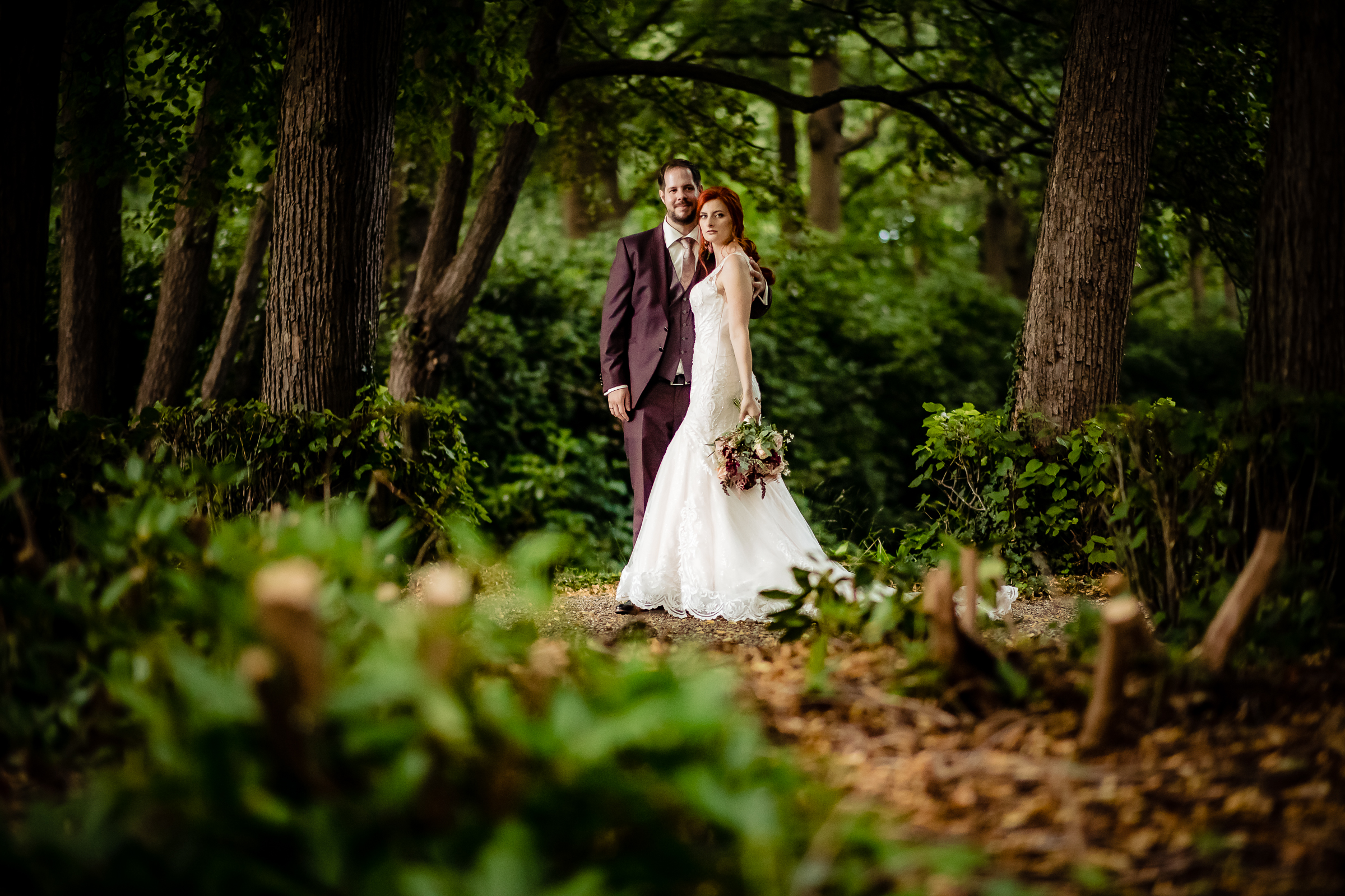 Classic portrait of couple standing in forest grove - photo by Eppel Photography