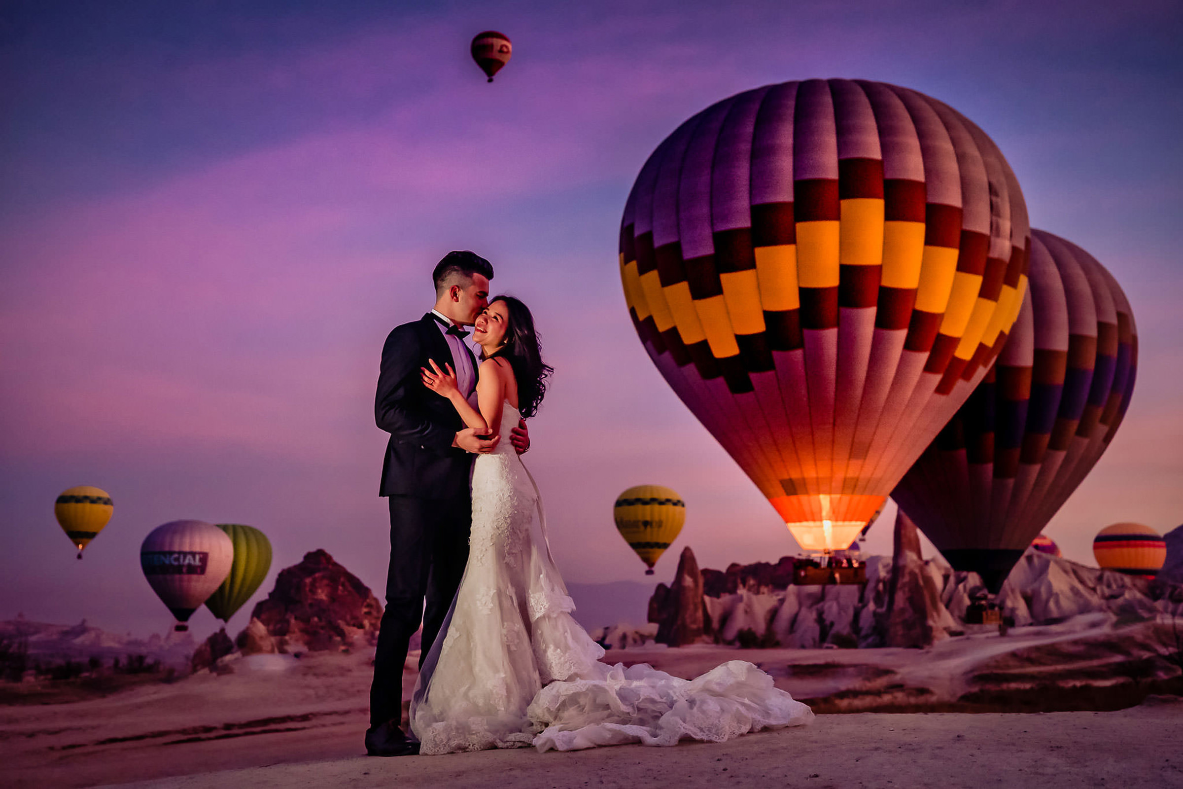 Couple against hot air balloons - photo by Eppel Photography