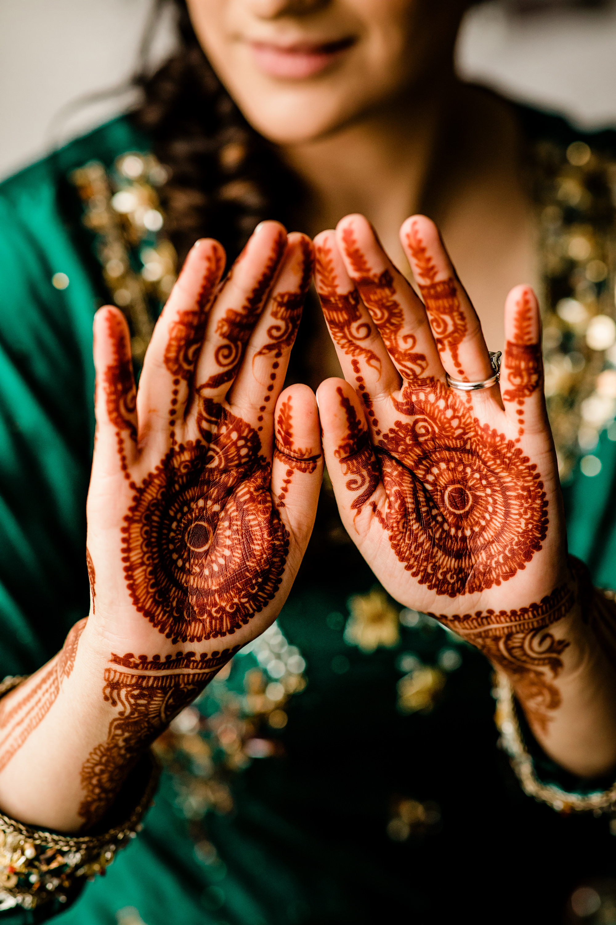 Bride shows henna hands - photo by Alante Photography