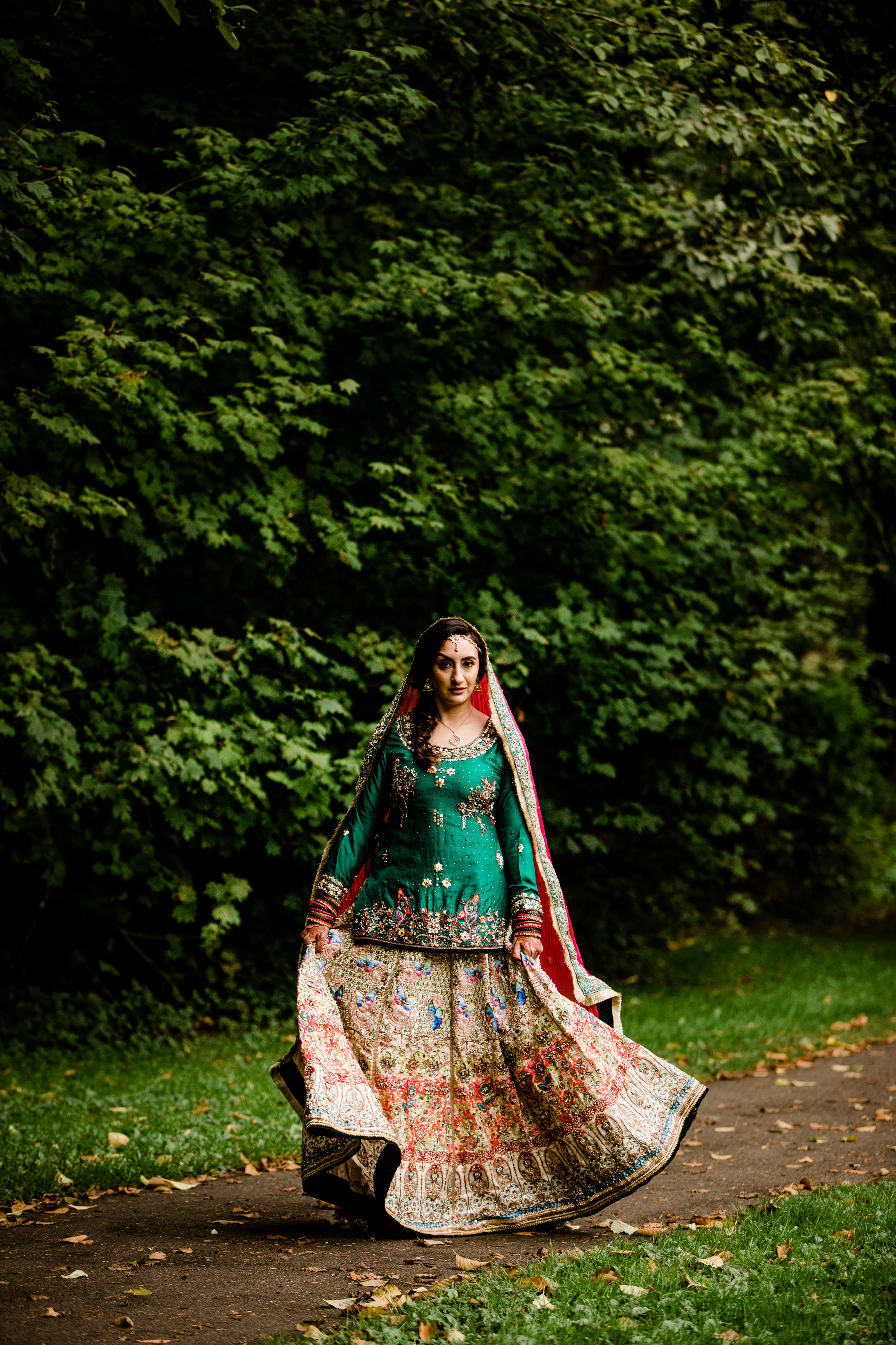 Full length Indian bride outdoor portrait - photo by Alante Photography