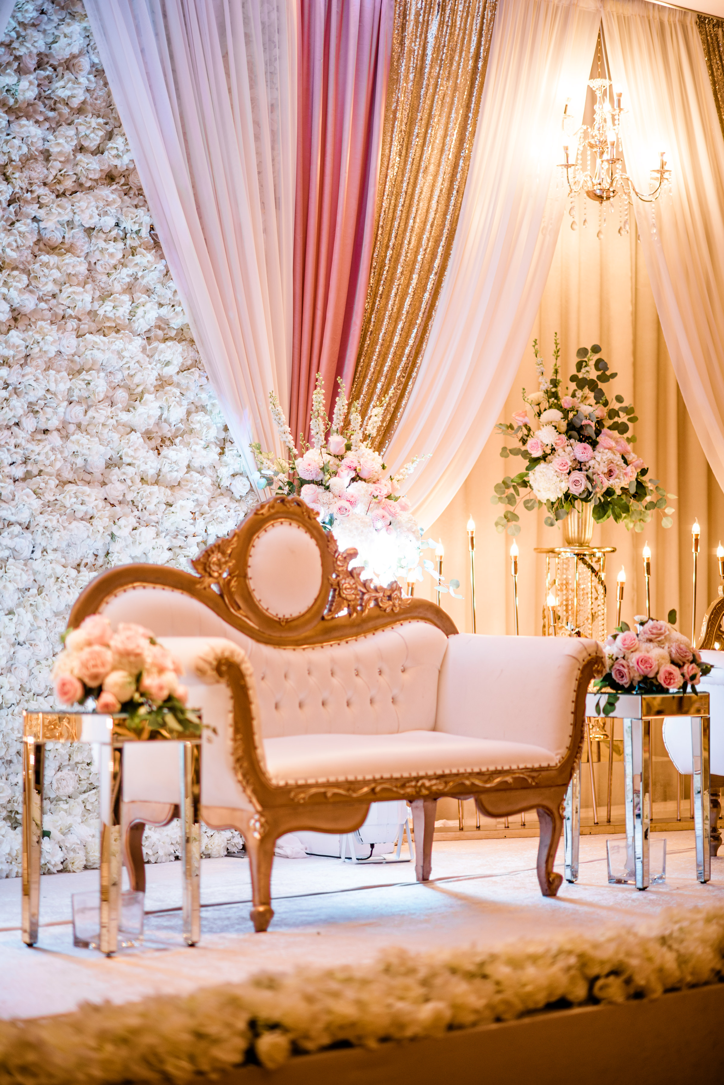 Luxurious loveseat against drapes and flowers and candles - photo by Alante Photography