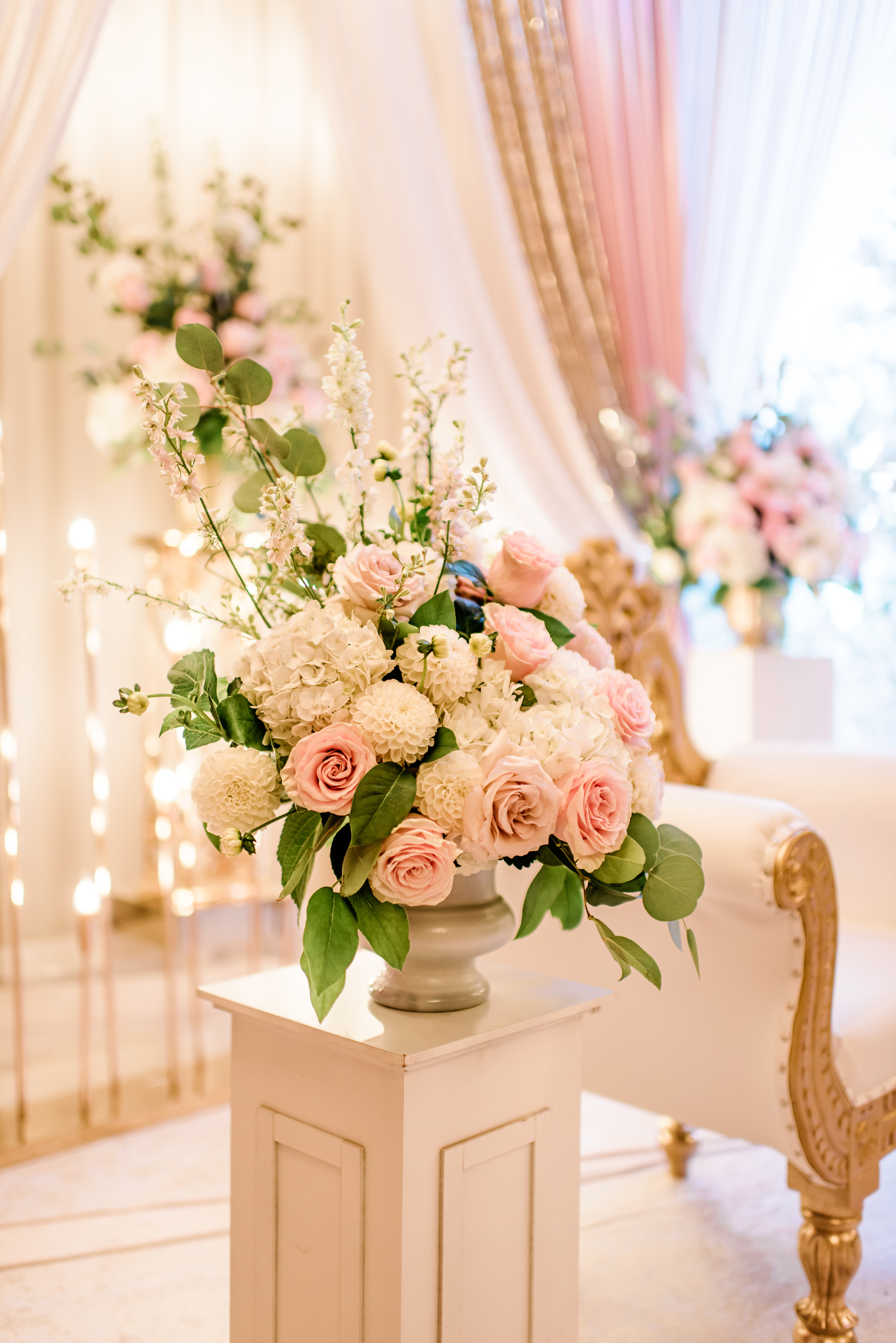 Pink on pink roses drapes and loveseat - photo by Alante Photography