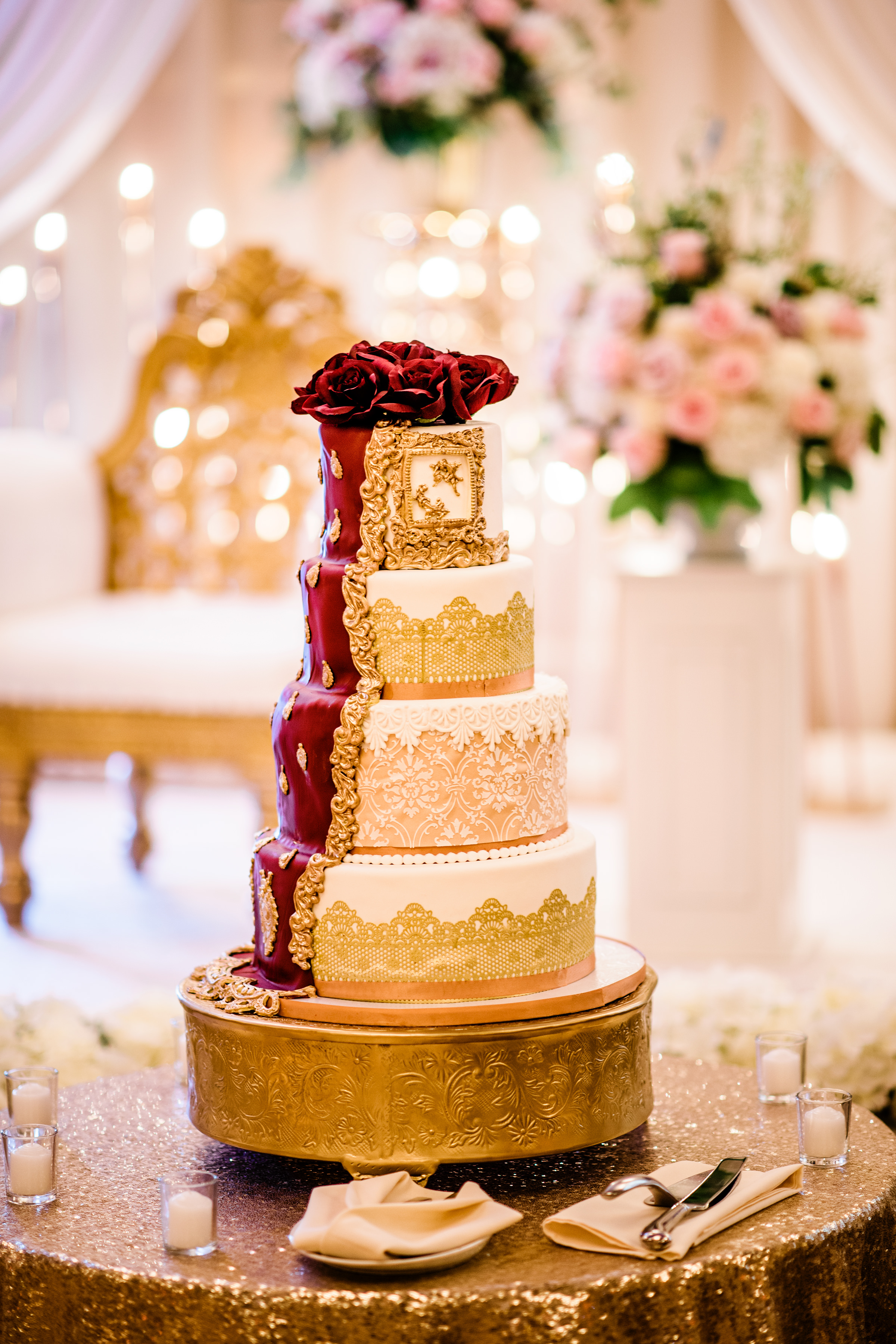 Tiered wedding cake with red roses - photo by Alante Photography