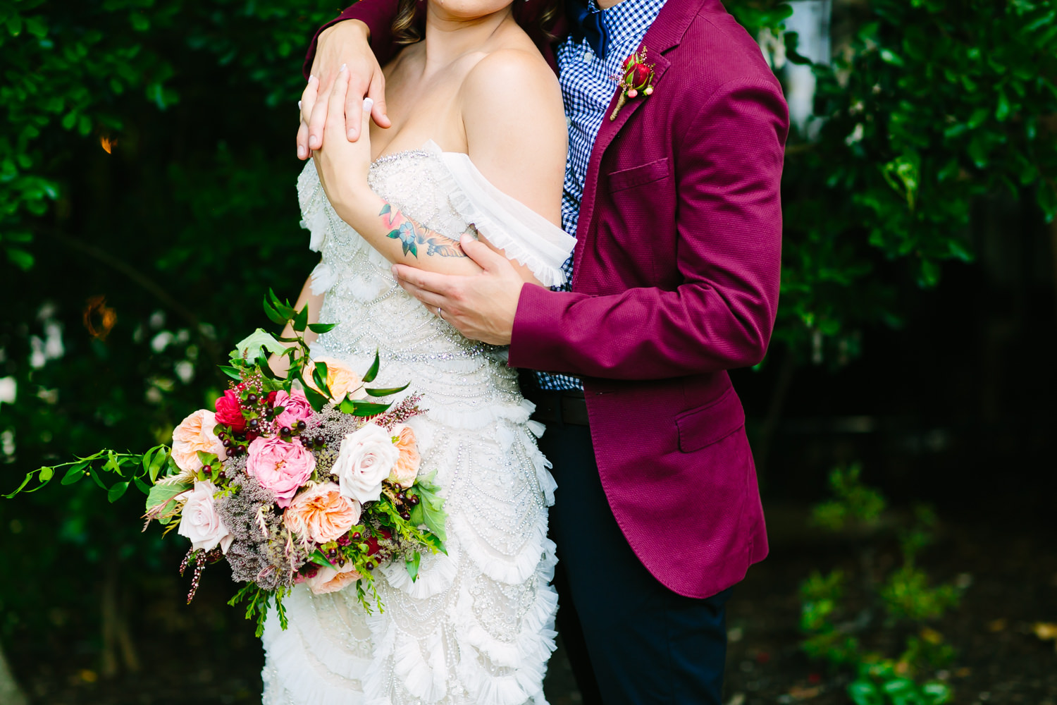 Bride and colorful groom - photo by AL Gawlik Photography
