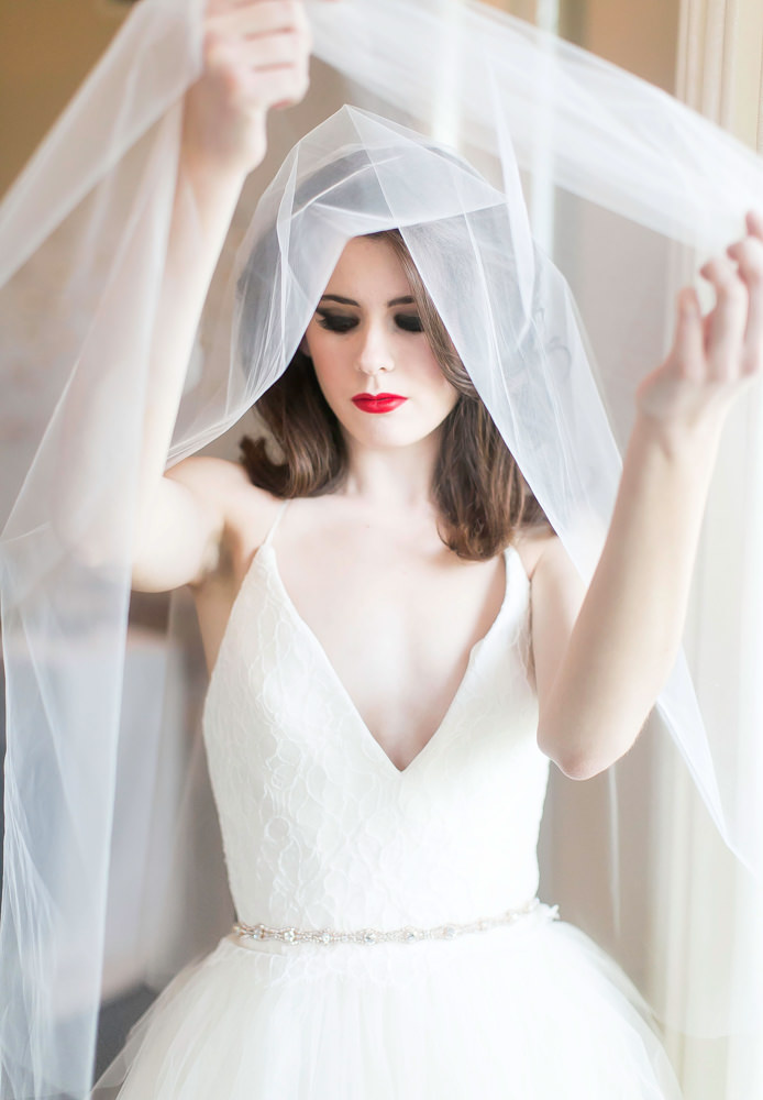 Bride draping her veil- photo by AL Gawlik Photography
