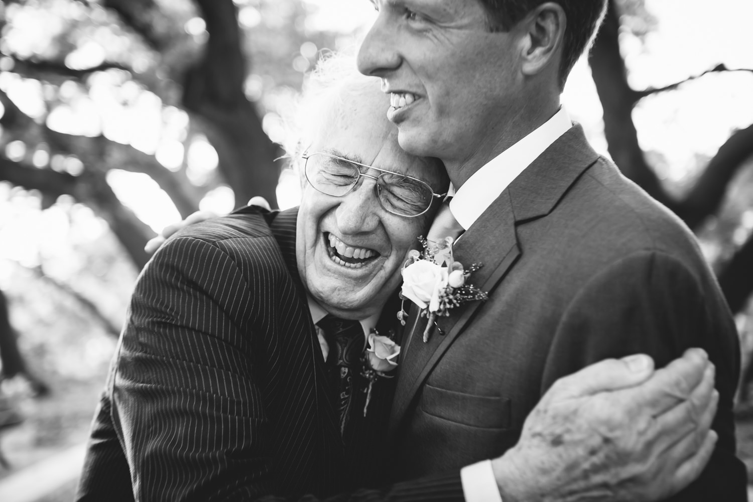 Joyful father hugs his son, the groom - photo by AL Gawlik Photography