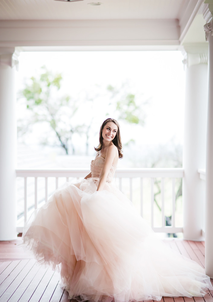 Smiling bride pose - photo by AL Gawlik Photography