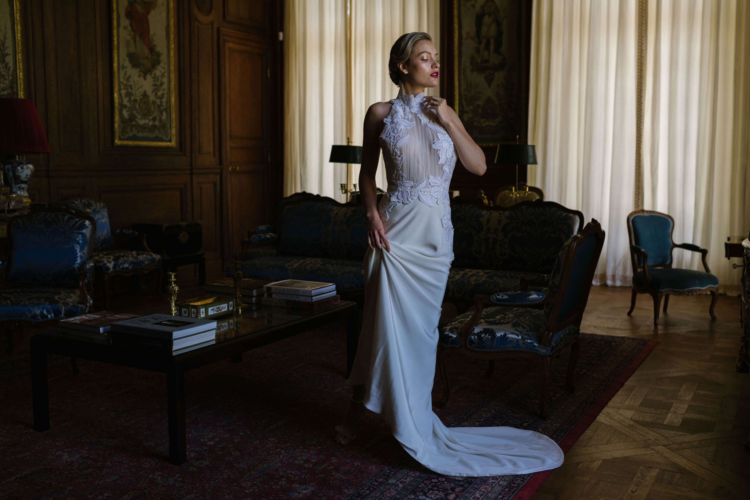 Fashionable photo of bride in crepe gown with applique bodice by Thierry Joubert Photography