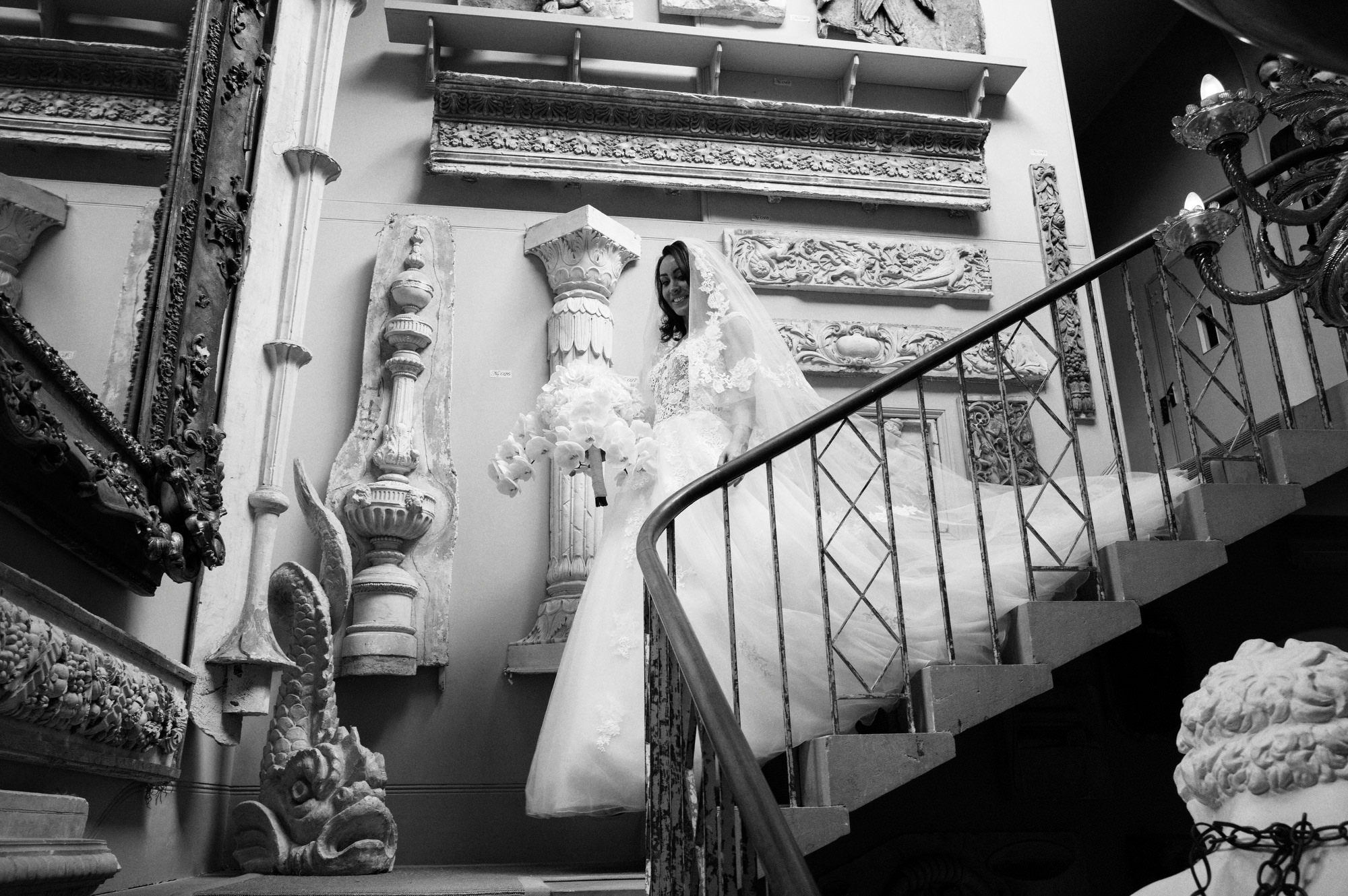 Bride descending ornate staircase at Aynho Park Hotel UK- photo by Jeff Ascough