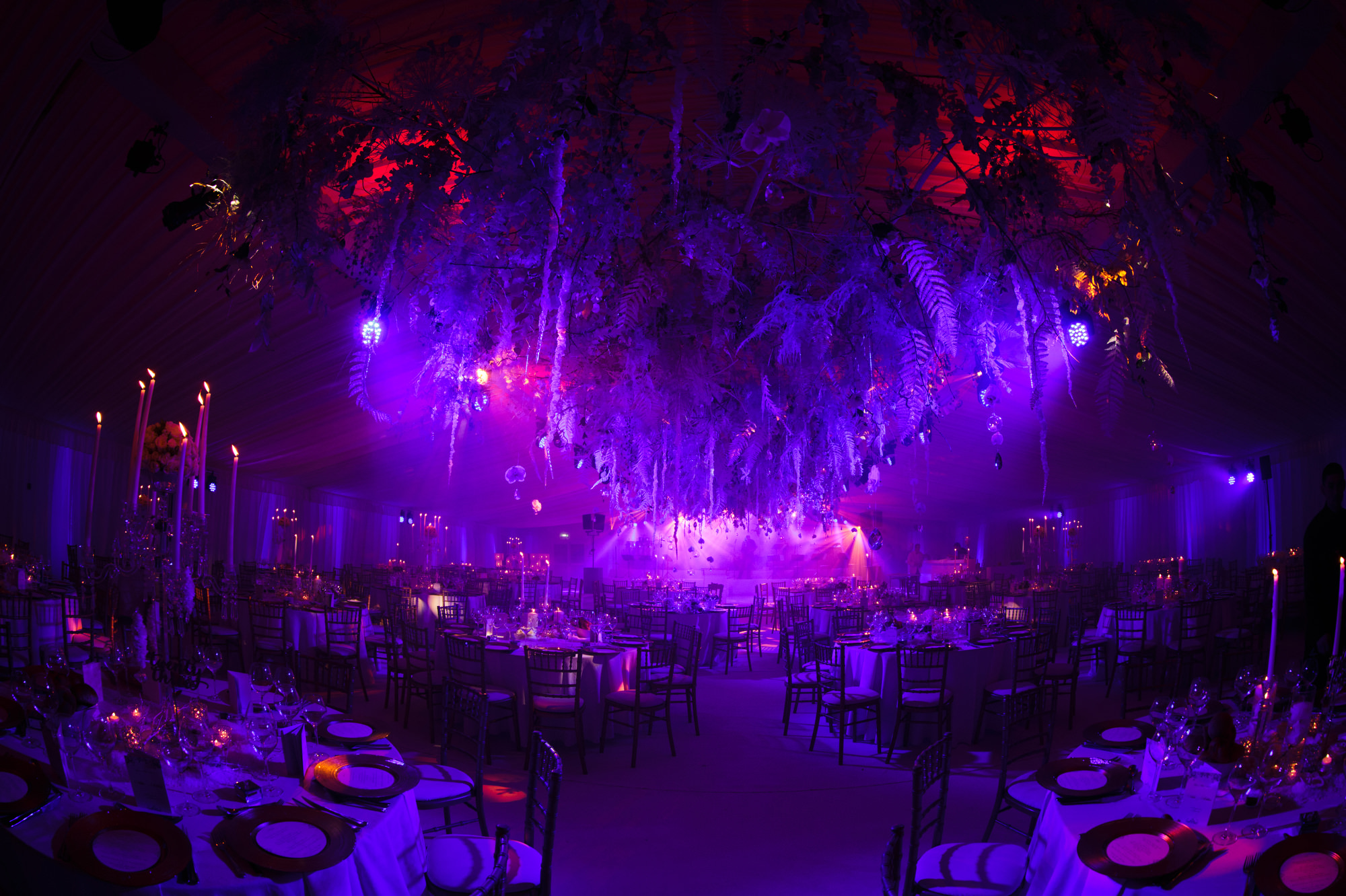 Red and purple lit reception hall at Rudding Park Hotel - photo by Jeff Ascough