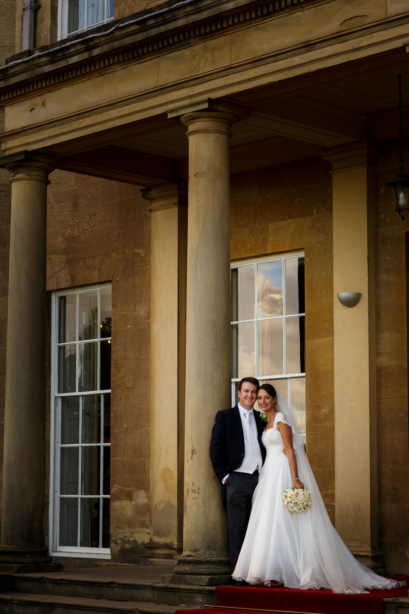 Standing couple portrait at Rudding Park Hotel UK - photo by Jeff Ascough