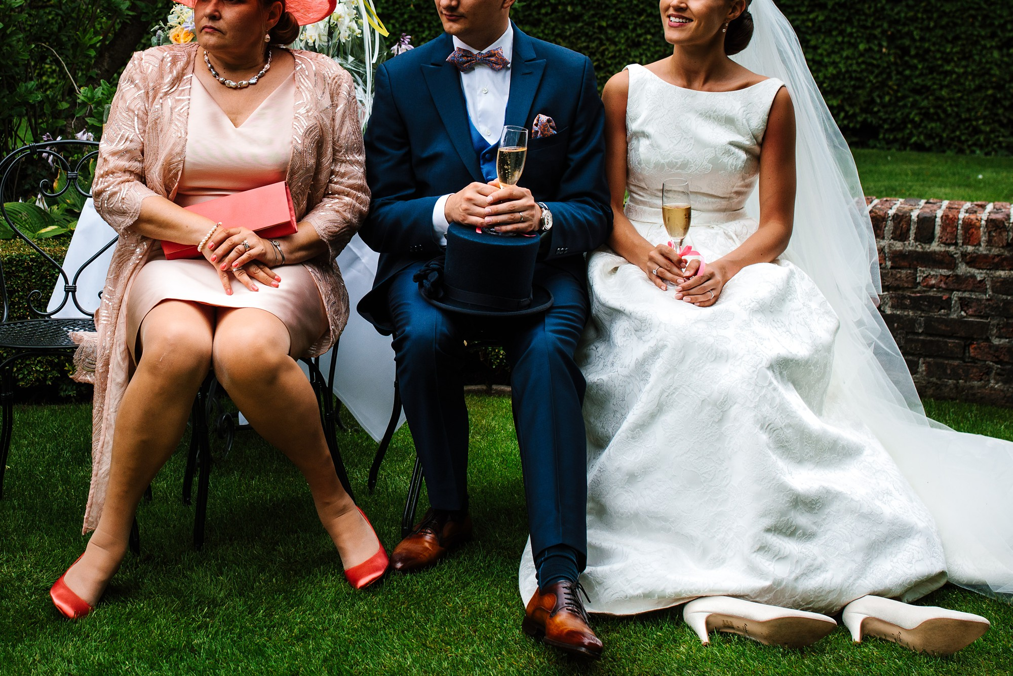 Group portrait focused on the feet of bride, groom and mom by Yves Schepers - Belgium wedding photographer