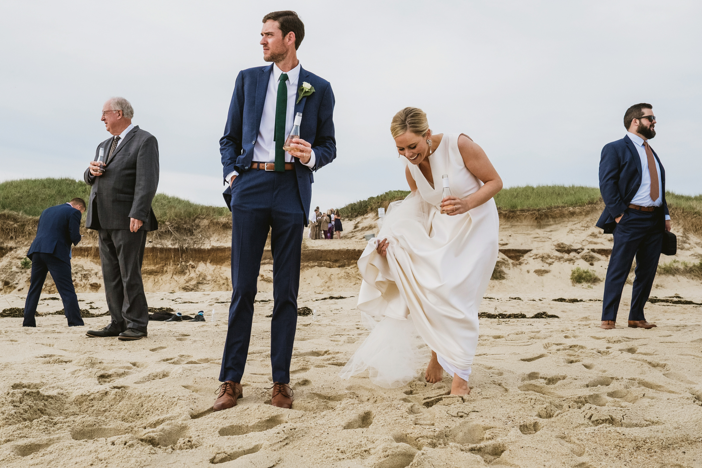 Couple and guests on the beach - photo by York Place Studios