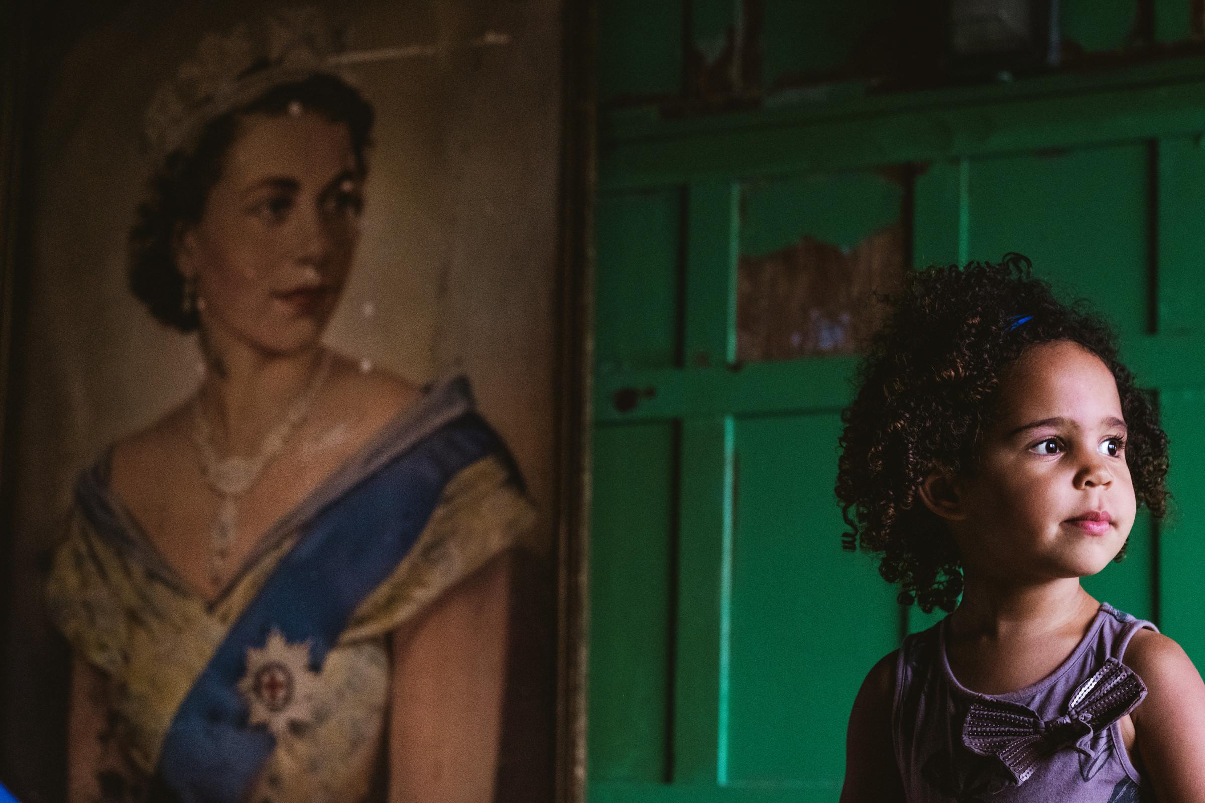 Little girl mimics portrait of a queen - photo by York Place Studios