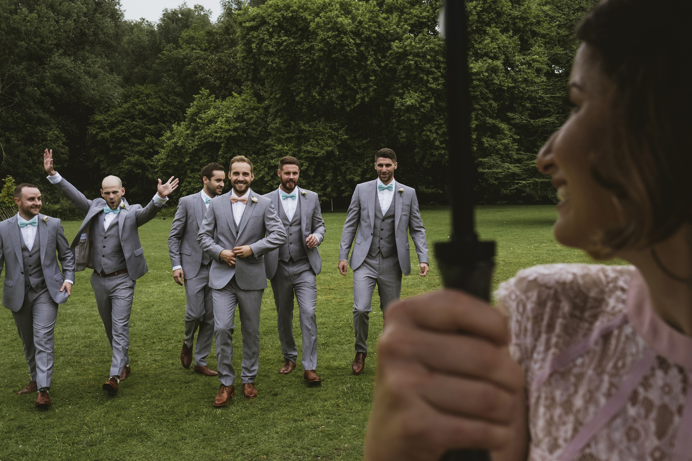 Groomsmen greet bride at Morden Hall grounds - photo by York Place Studios