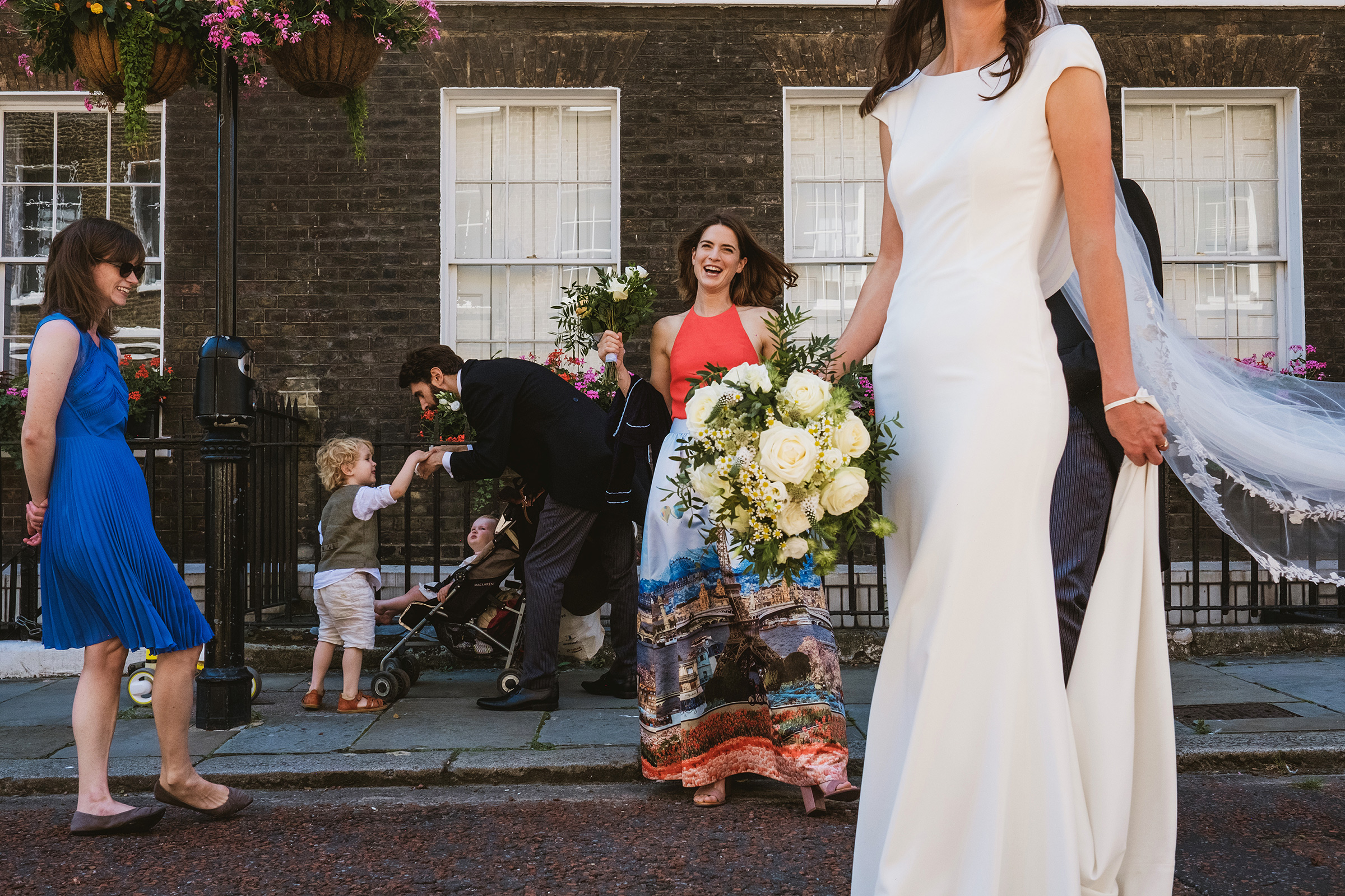 Chic bride portrait on street with others - photo by York Place Studios