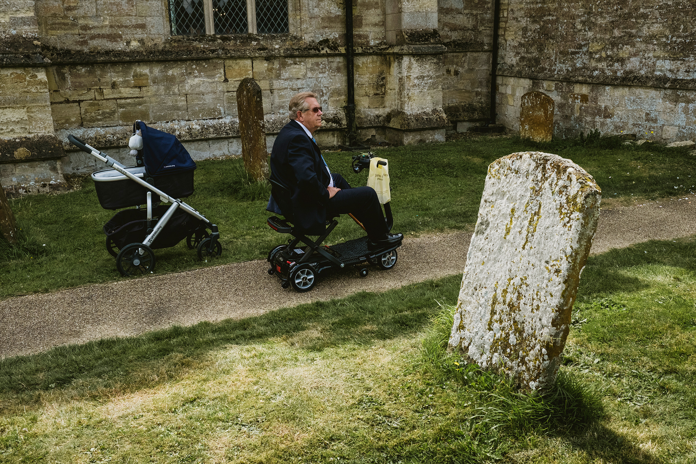 Grandfather next to baby carriage - photo by York Place Studios