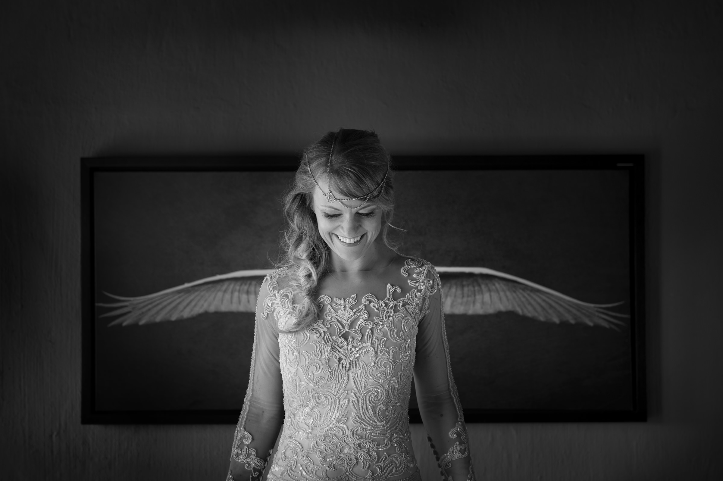 Bride in applique lace dress looks like she's wearing wings- photo by Jacki Bruniquel