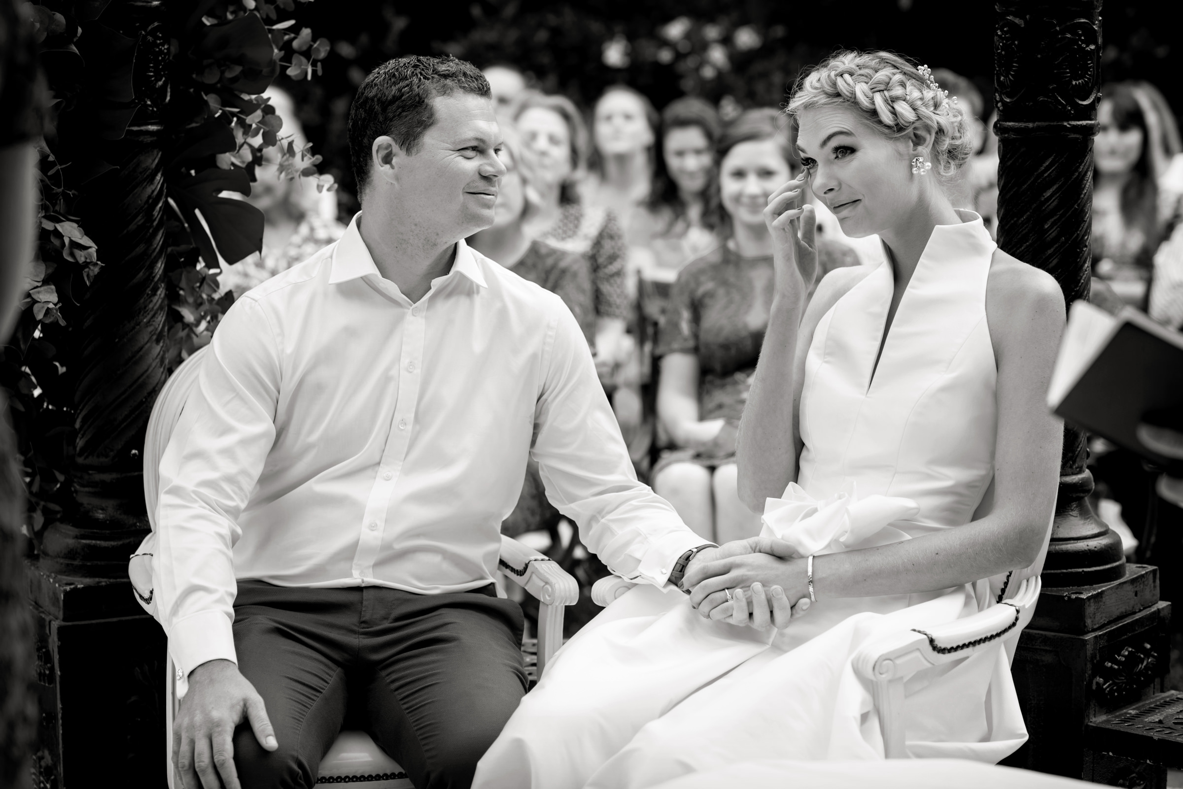 Groom comforts bride as she cries during ceremony - photo by Miki Studios