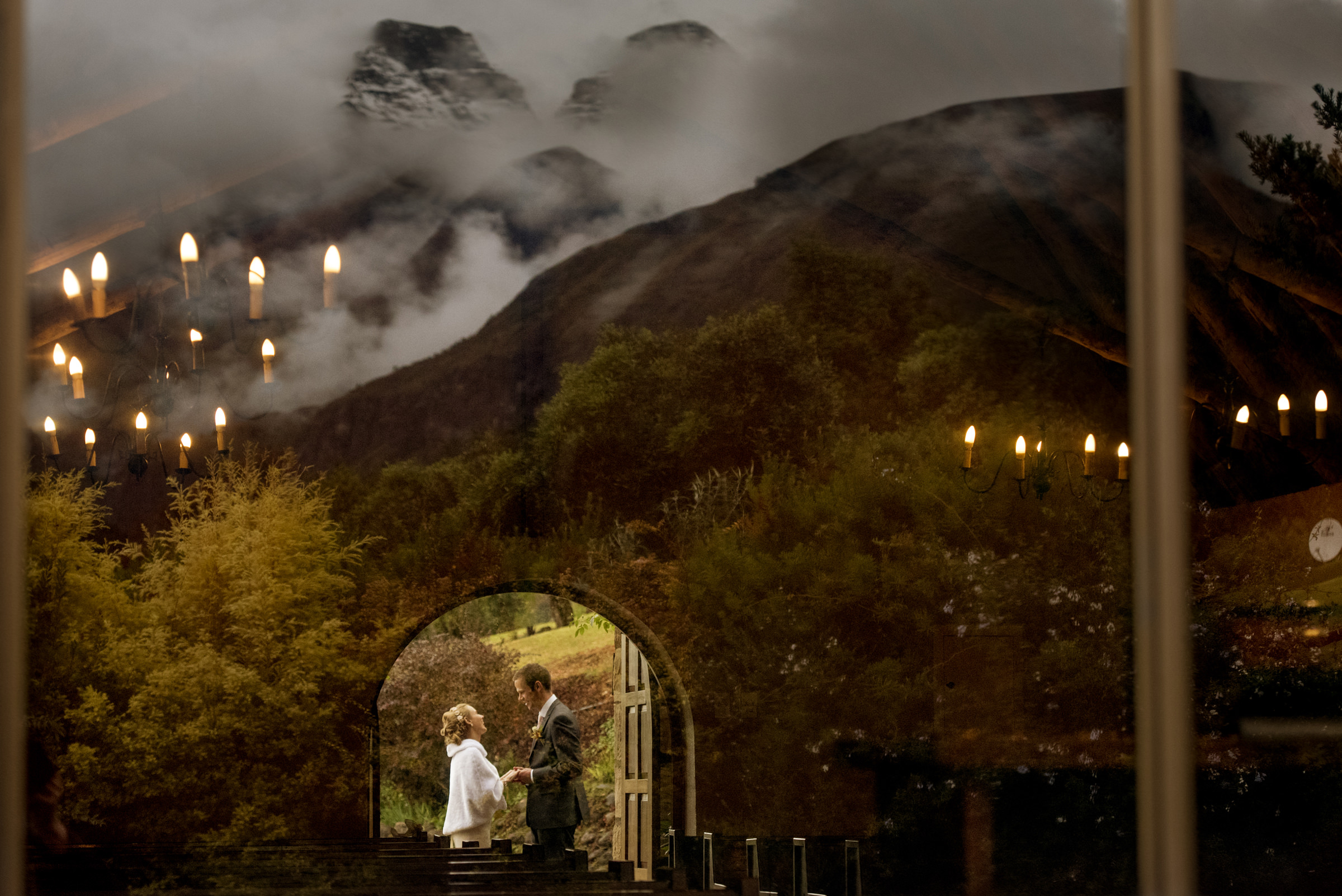 Landscape composite of couple holding hands outside of church door - photo by Jacki Bruniquel