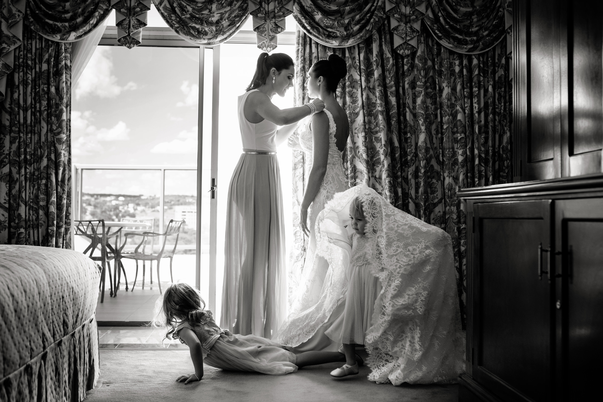 Little girls play under wedding train while bride gets ready - photo by Jacki Bruniquel
