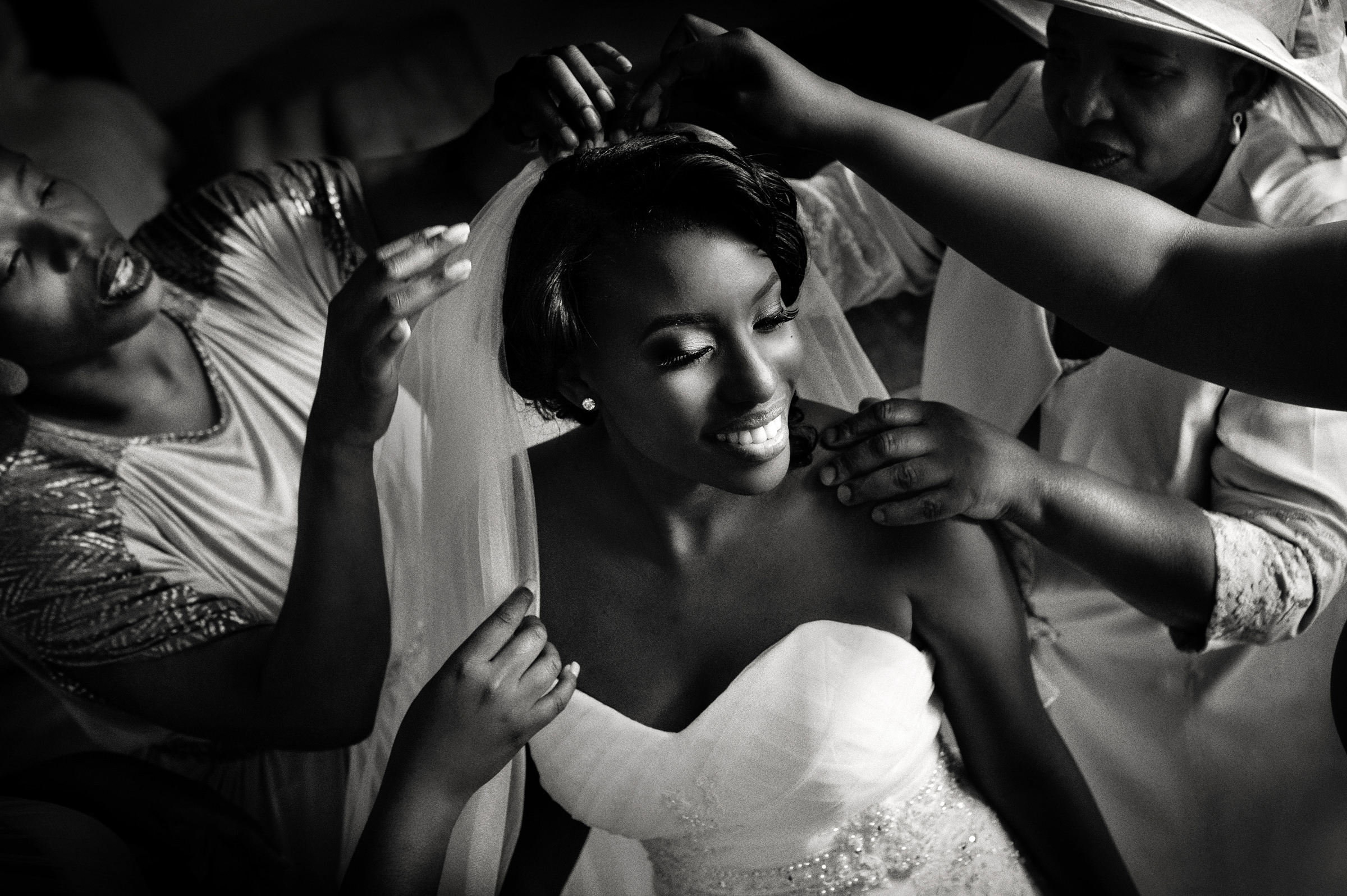 Women put veil on beautiful black bride - photo by Jacki Bruniquel