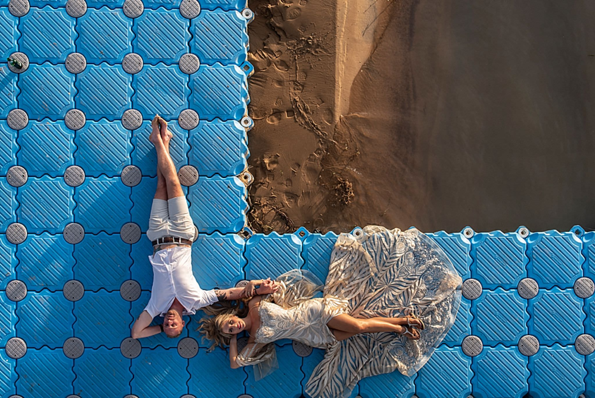 aerial view of couple above beach on aqua floor - photo by Jacki Bruniquel