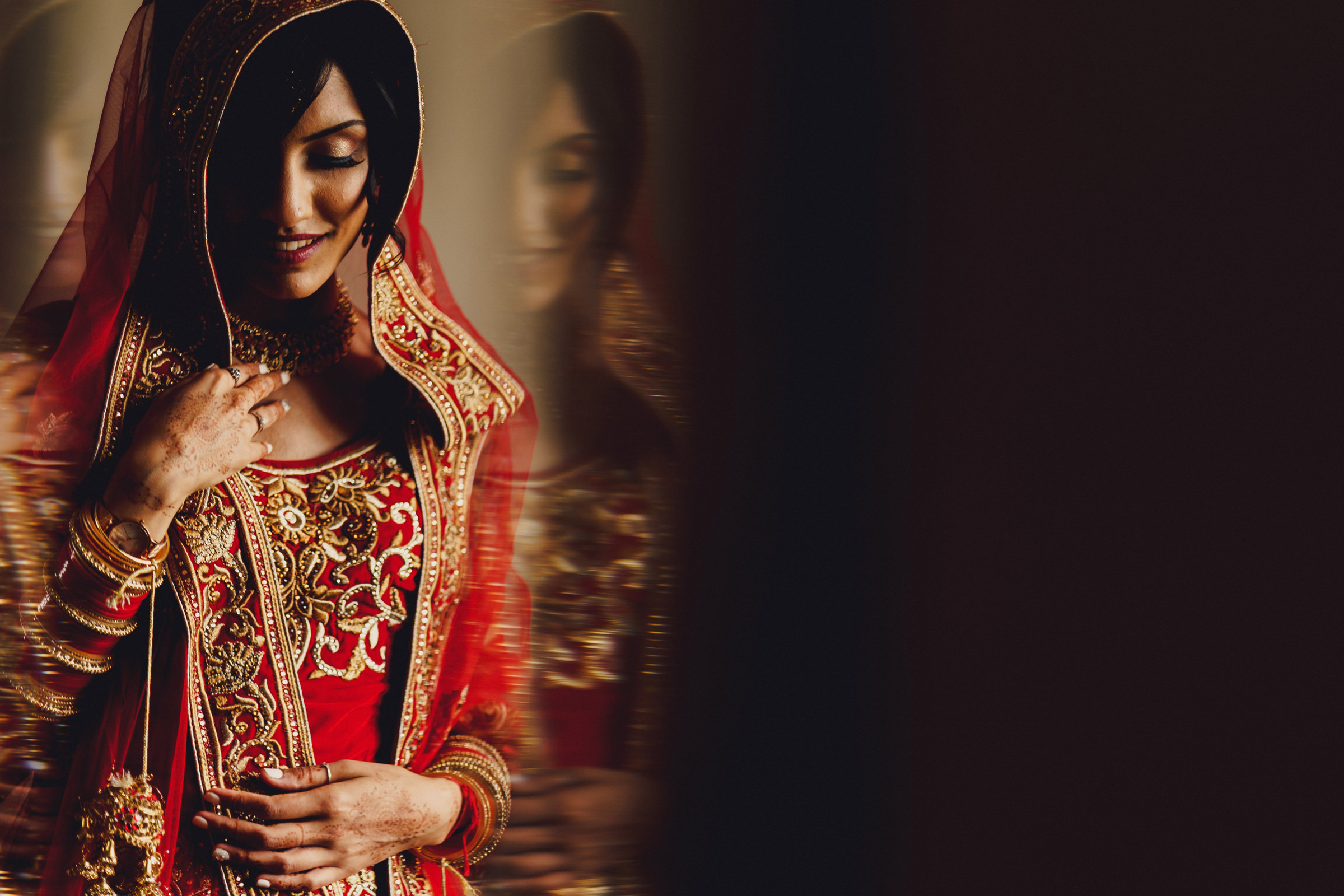 Bride in red and gold - photo by MIKI Studios