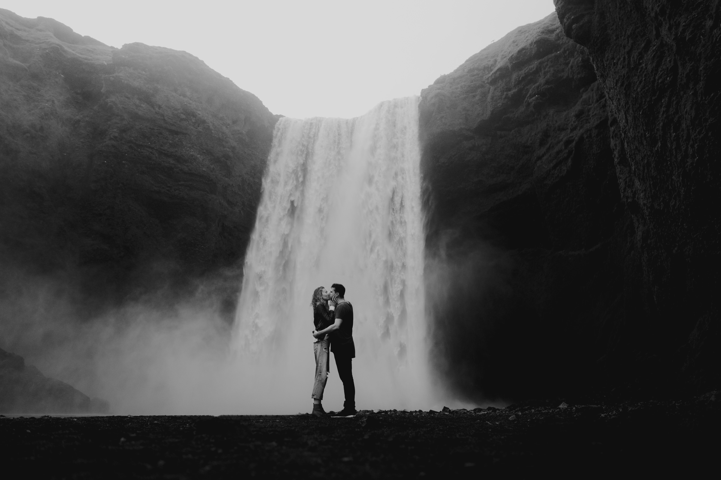 Couple kisses at waterfall - photo by MIKI Studios