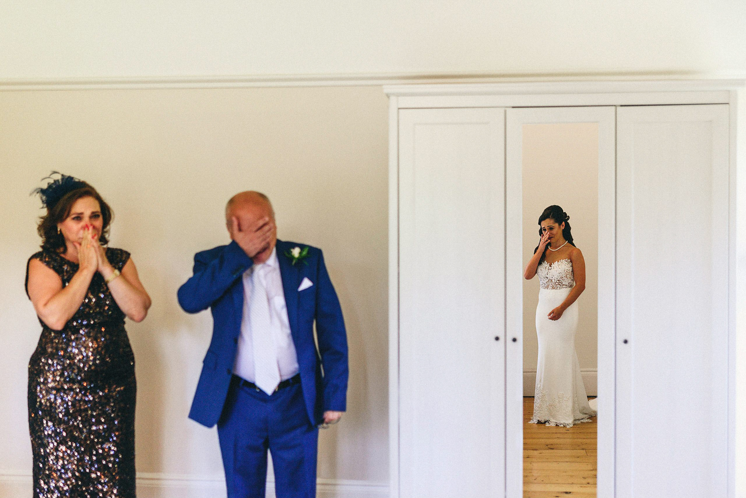 Emotional bride and parents - photo by MIKI STUDIOS