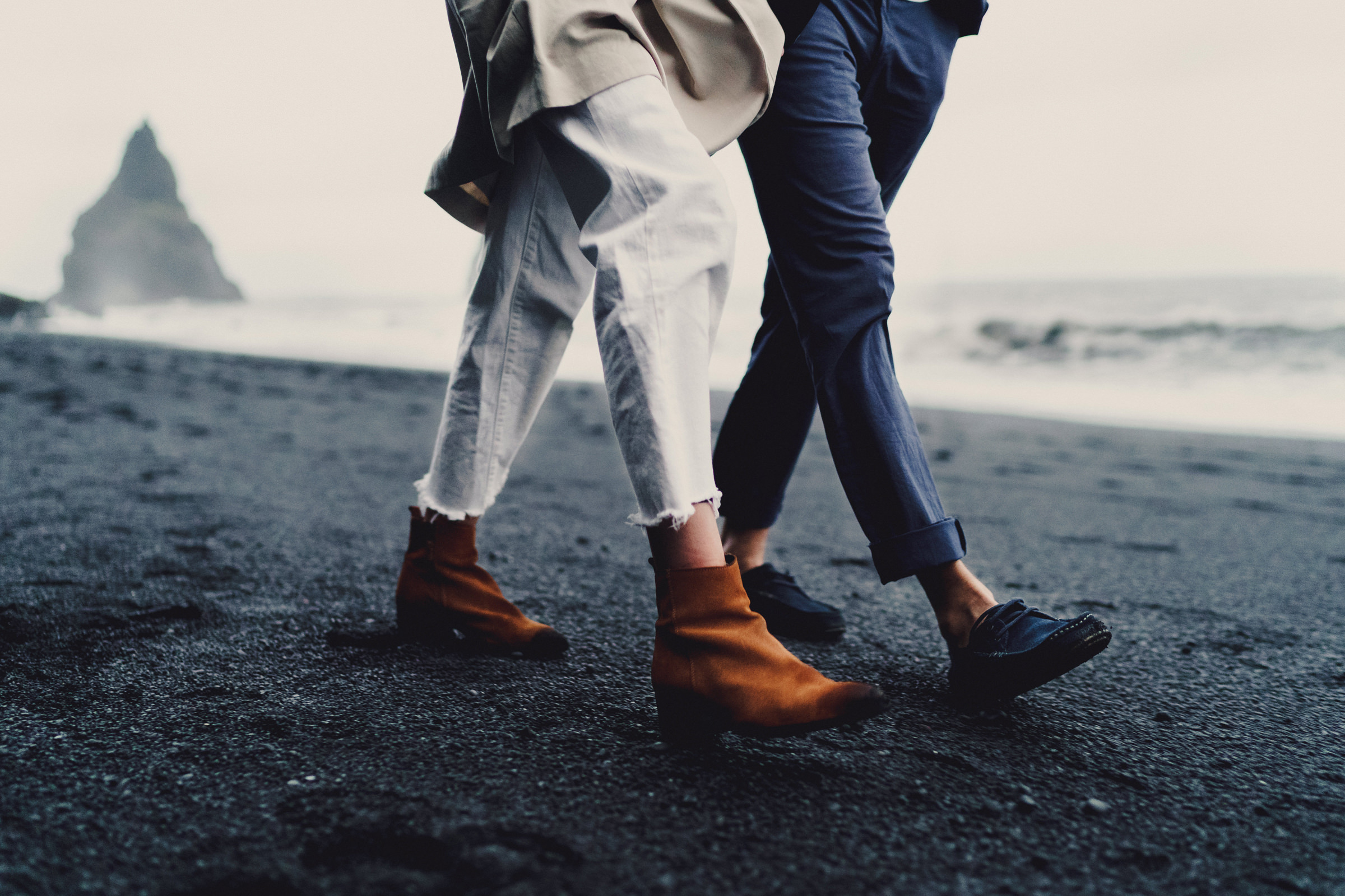 Engagement couple walks on beach- photo by MIKI Studios