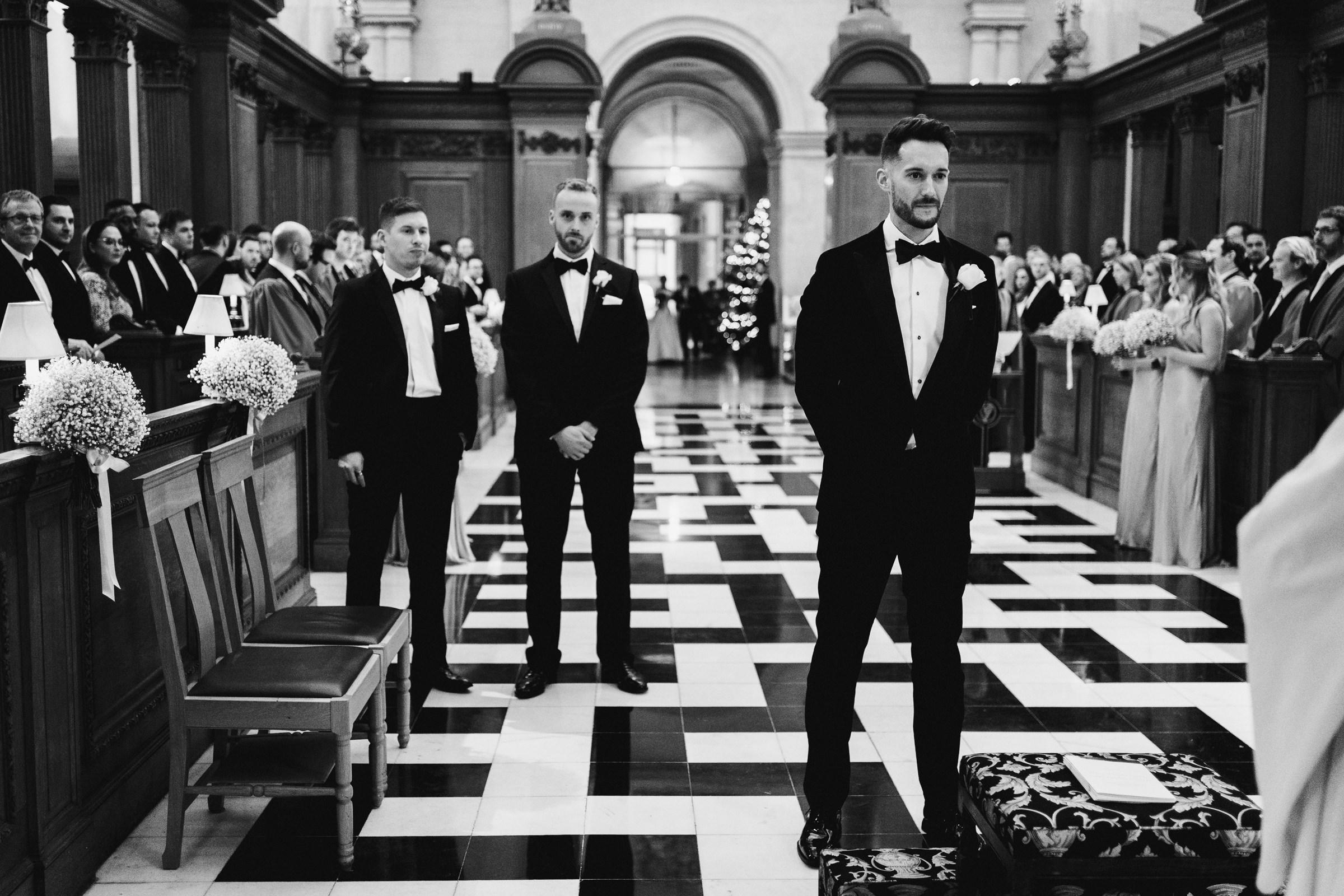 Groom awaits bride at altar - photo by MIKI Studios