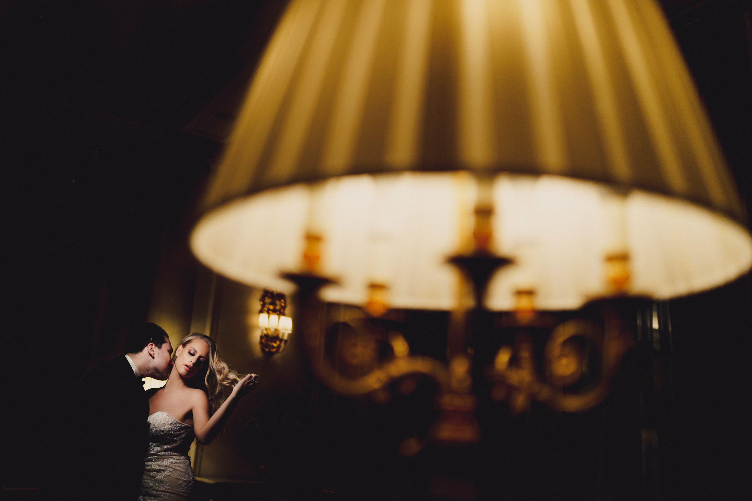 Groom kisses bride's neck - photo by MIKI STUDIOS