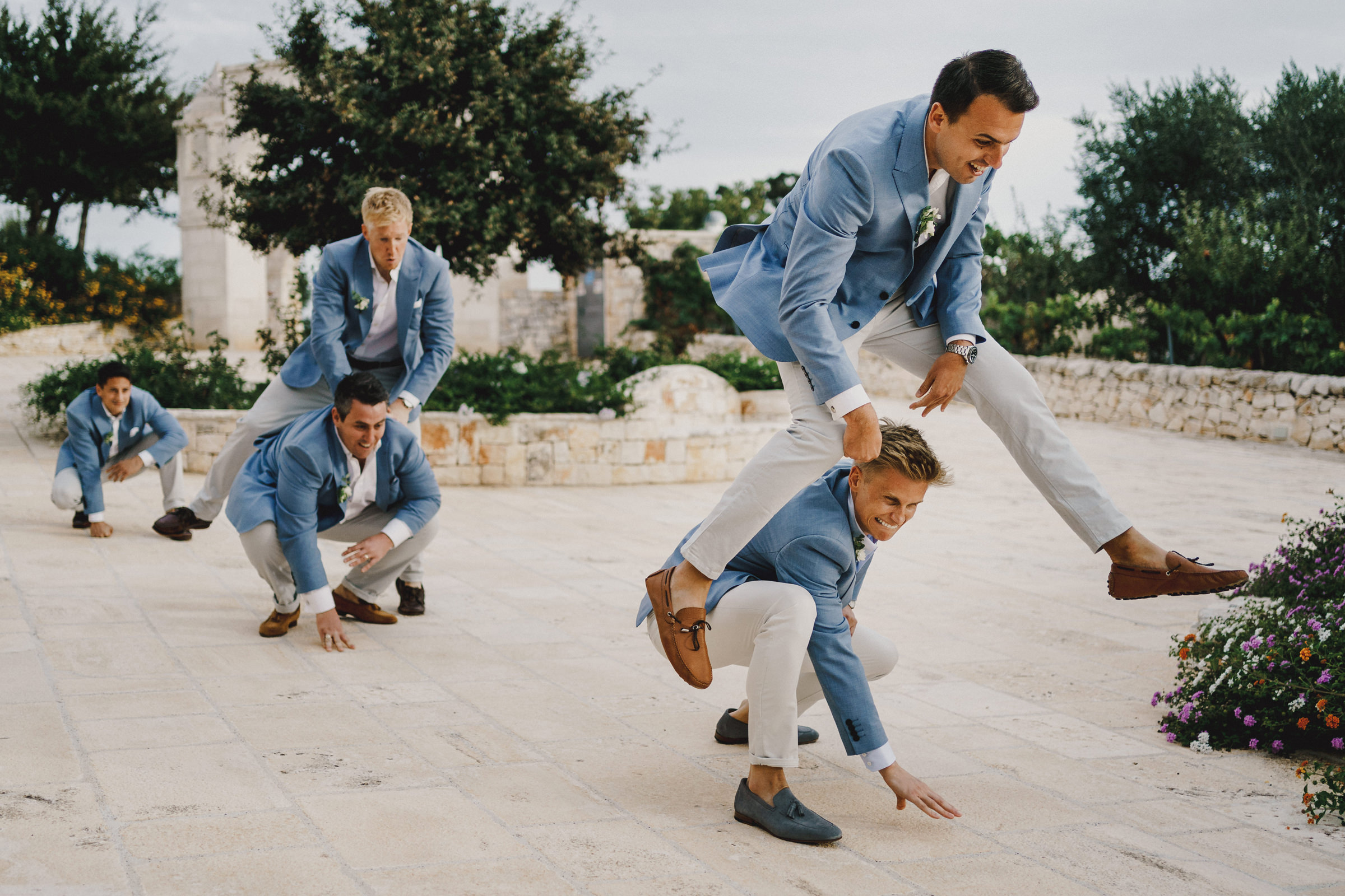 Groomsmen playing leapfrog 2- photo by MIKI Studios