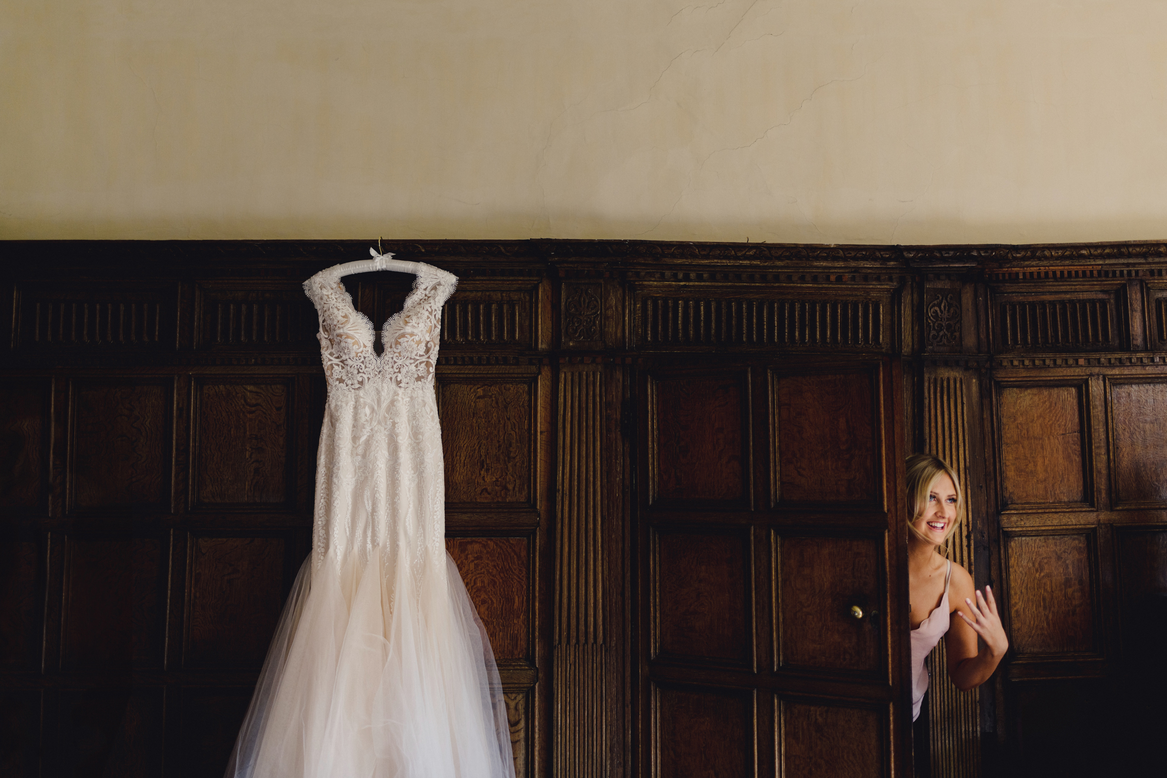 Bride entering wood paneled room for her gown - photo by MIKI Studios
