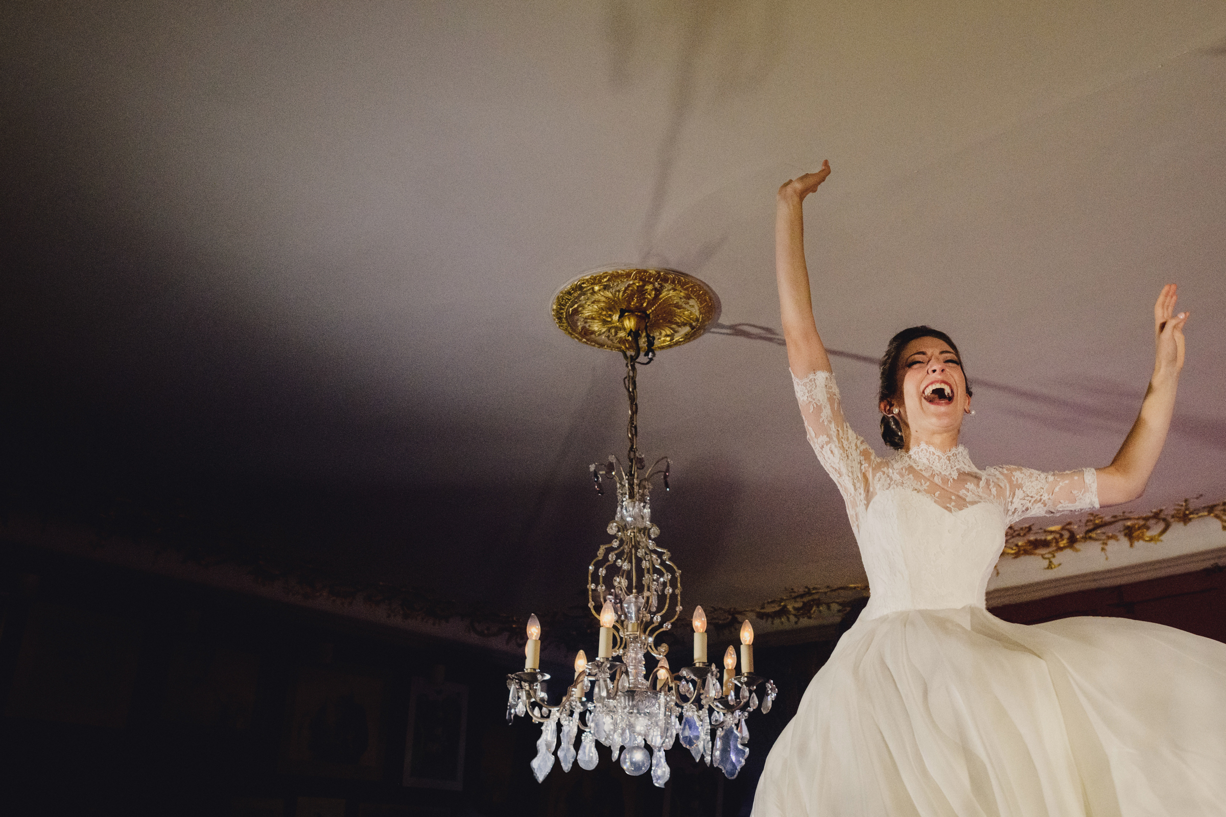 Bride raises the roof during hora dance - photo by MIKI Studios in London