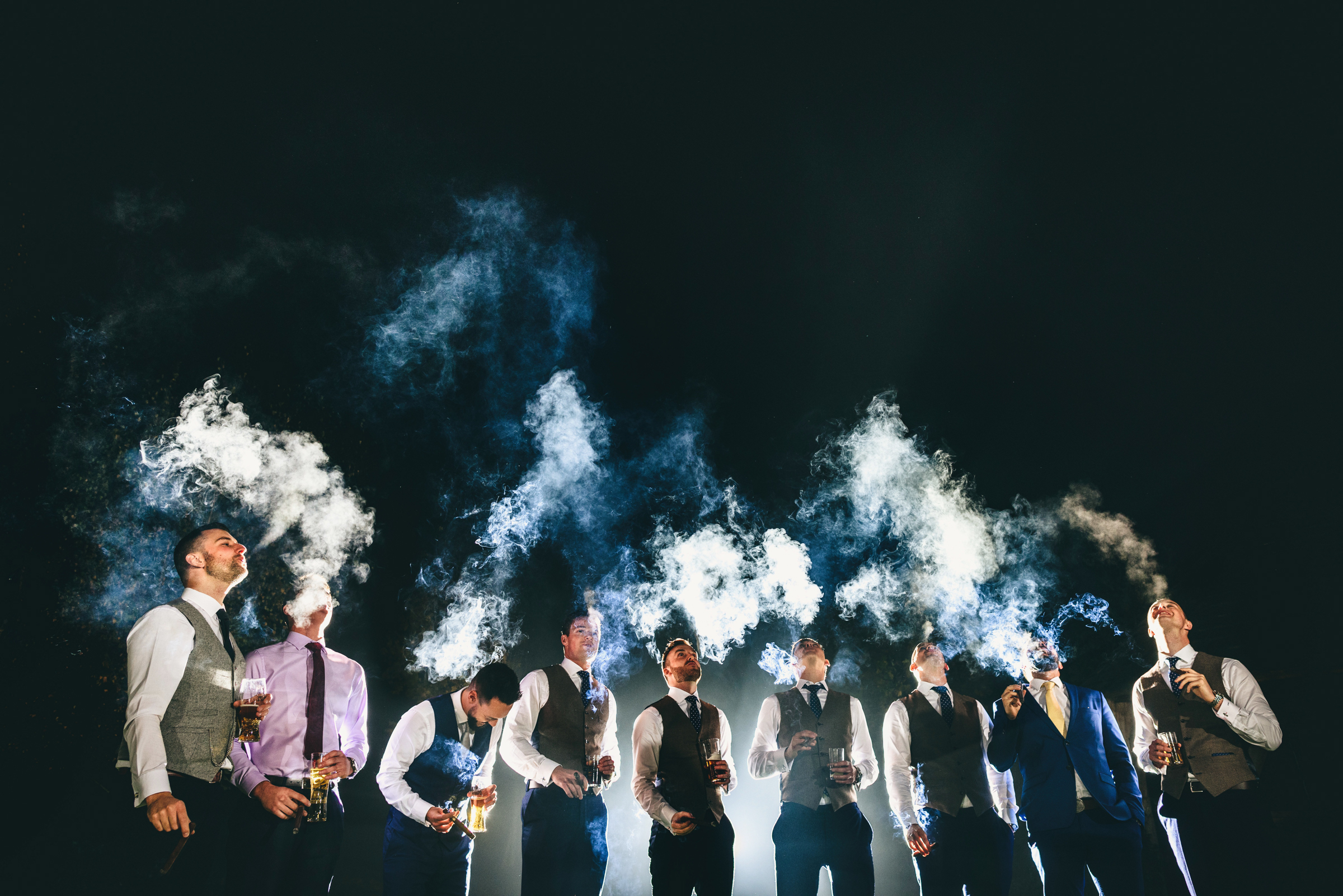 Group portrait of groom and groomsmen with cigar by MIKI Studios