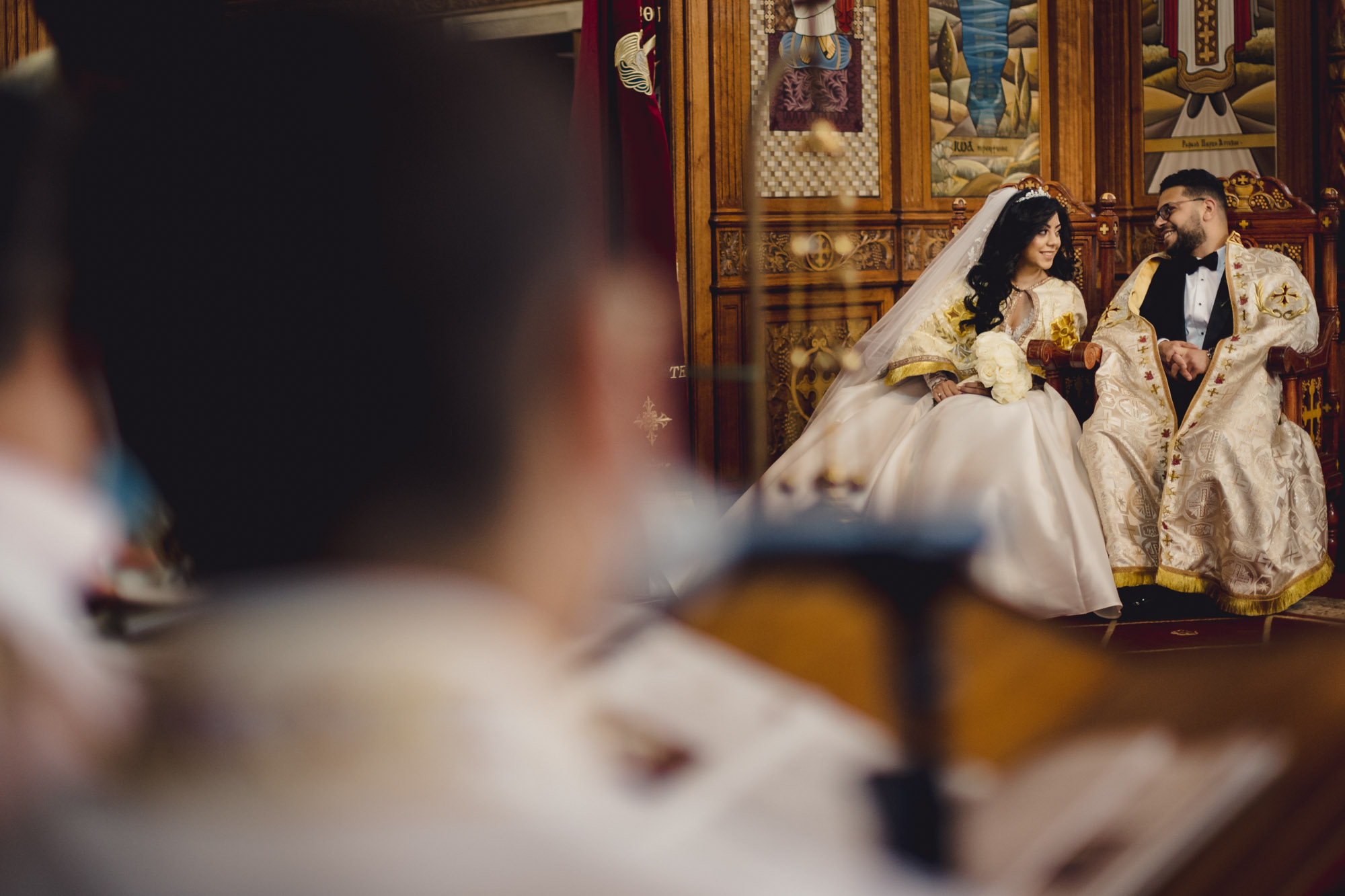 Bride and groom in religious ceremonial robe - photo by MIKI Studios