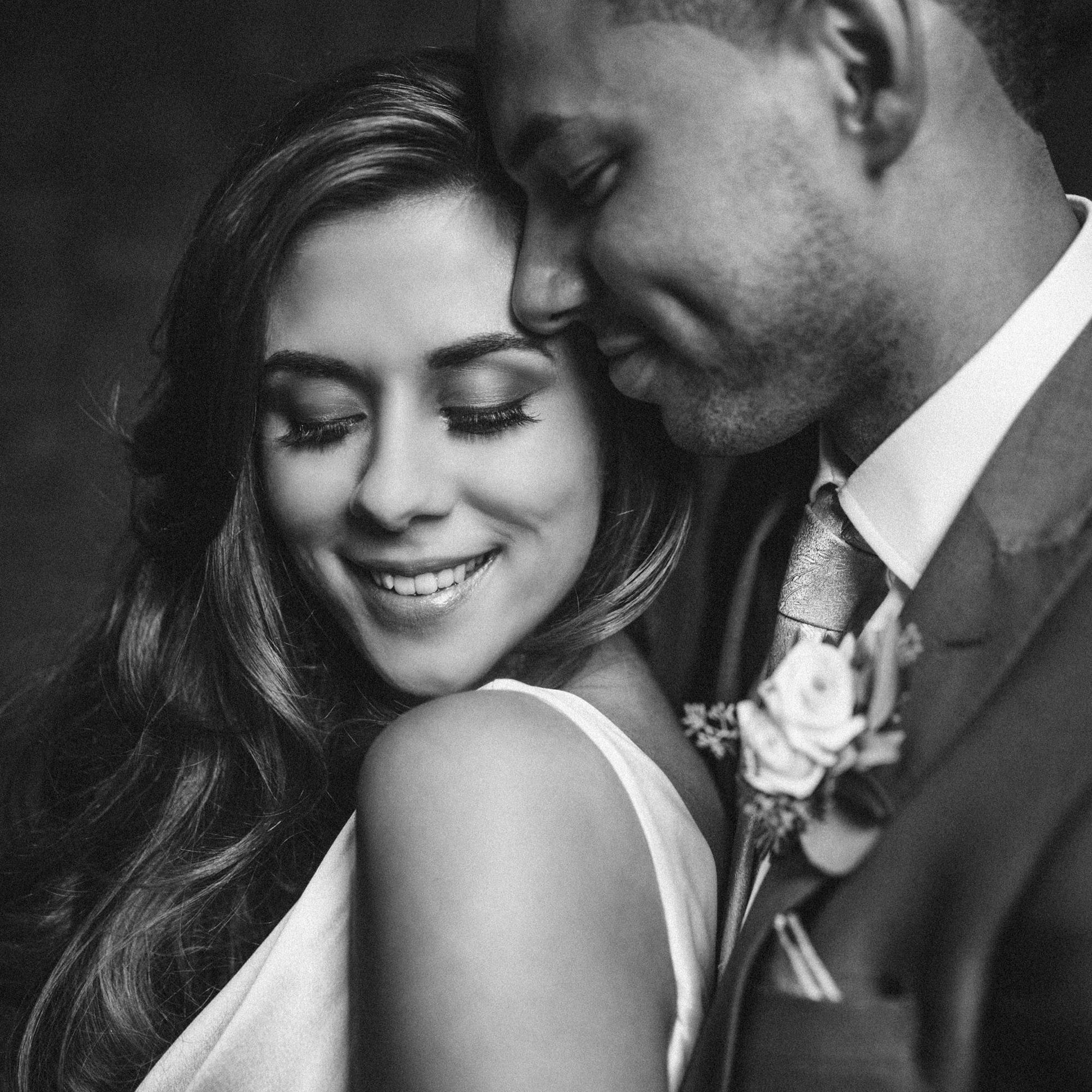 bride and groom nuzzling portrait- photo by MIKI Studios