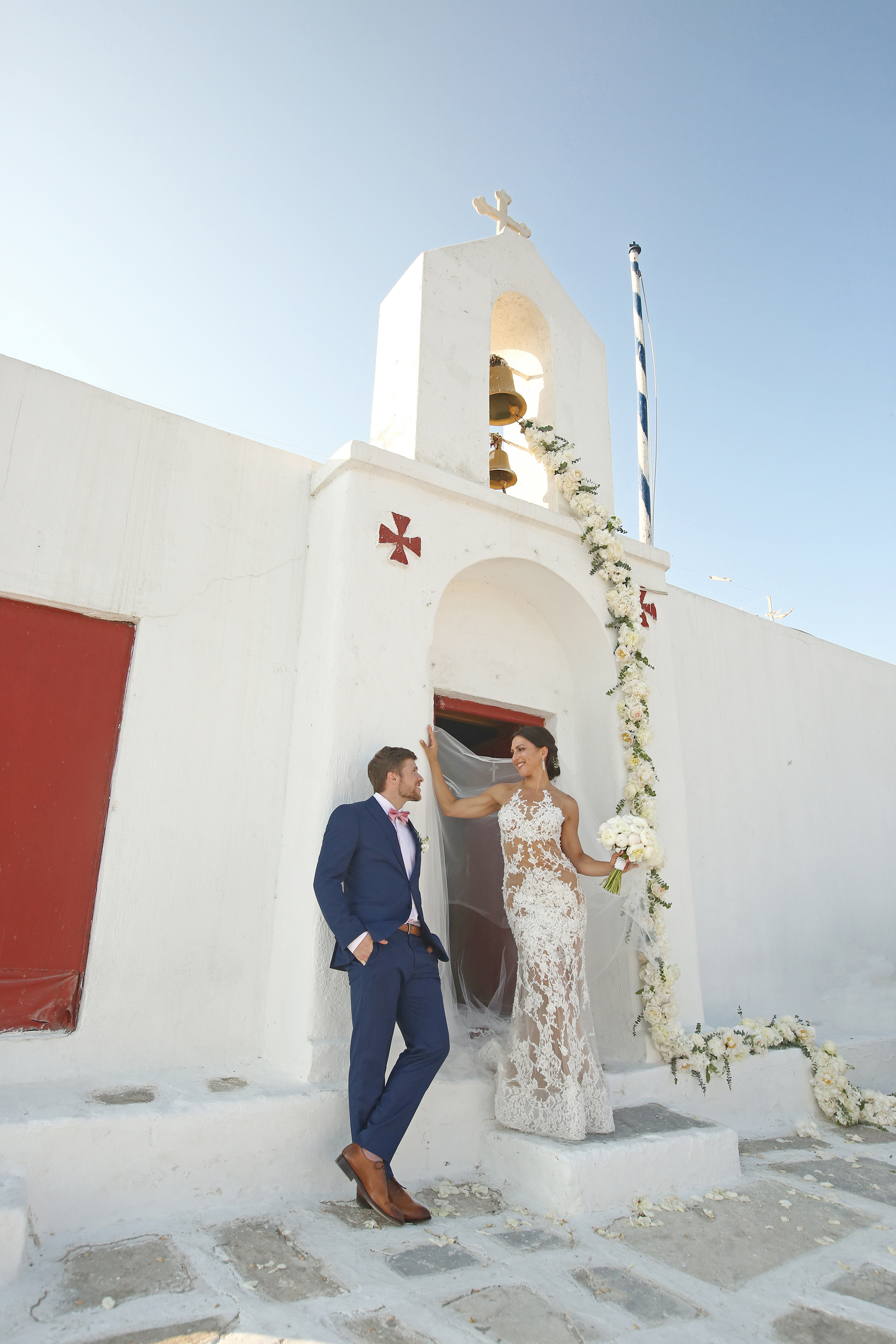 Bride and groom outside of church - photo by Kenny Kim Photography