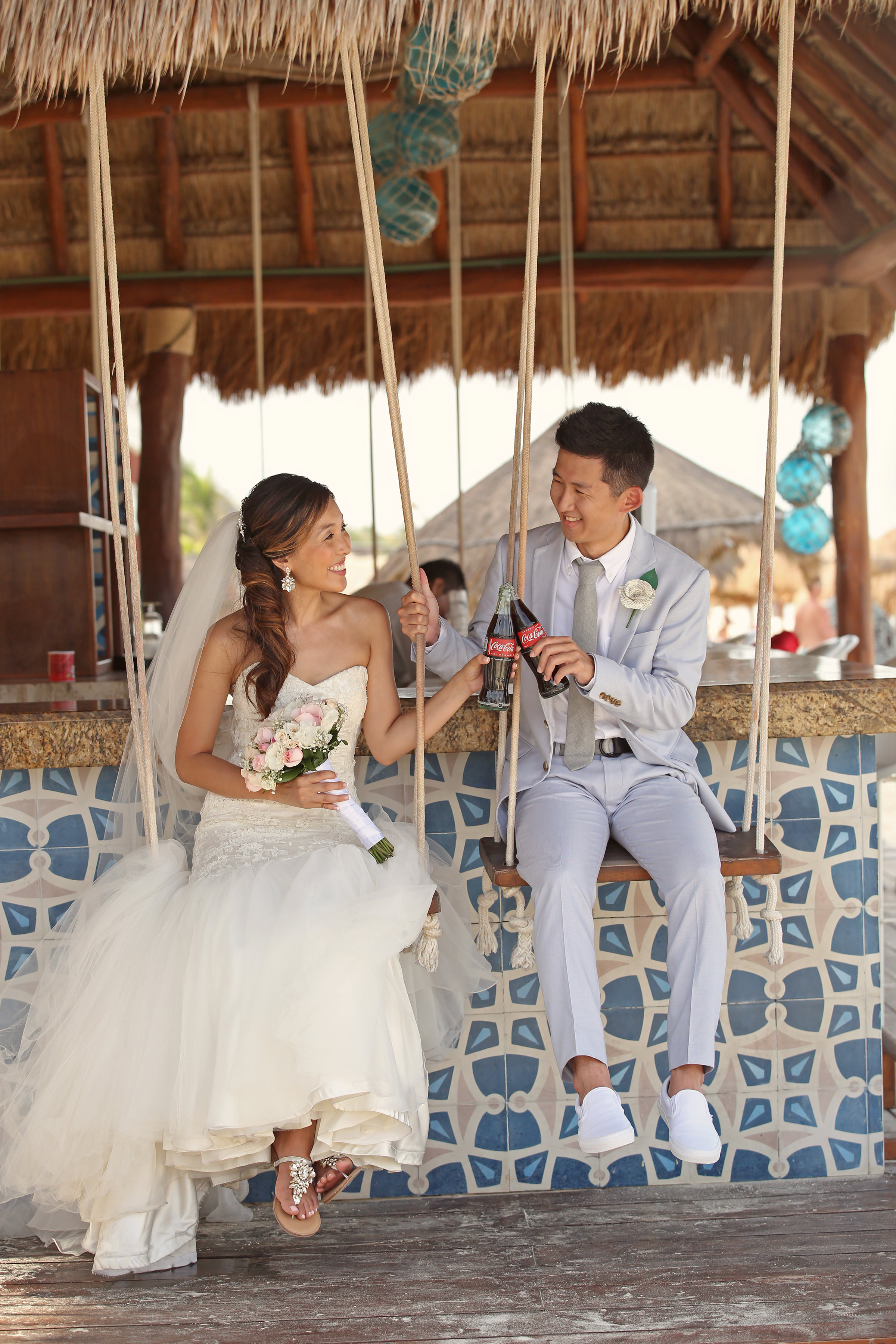 Bride and groom toast with cokes - photo by Kenny Kim Photography